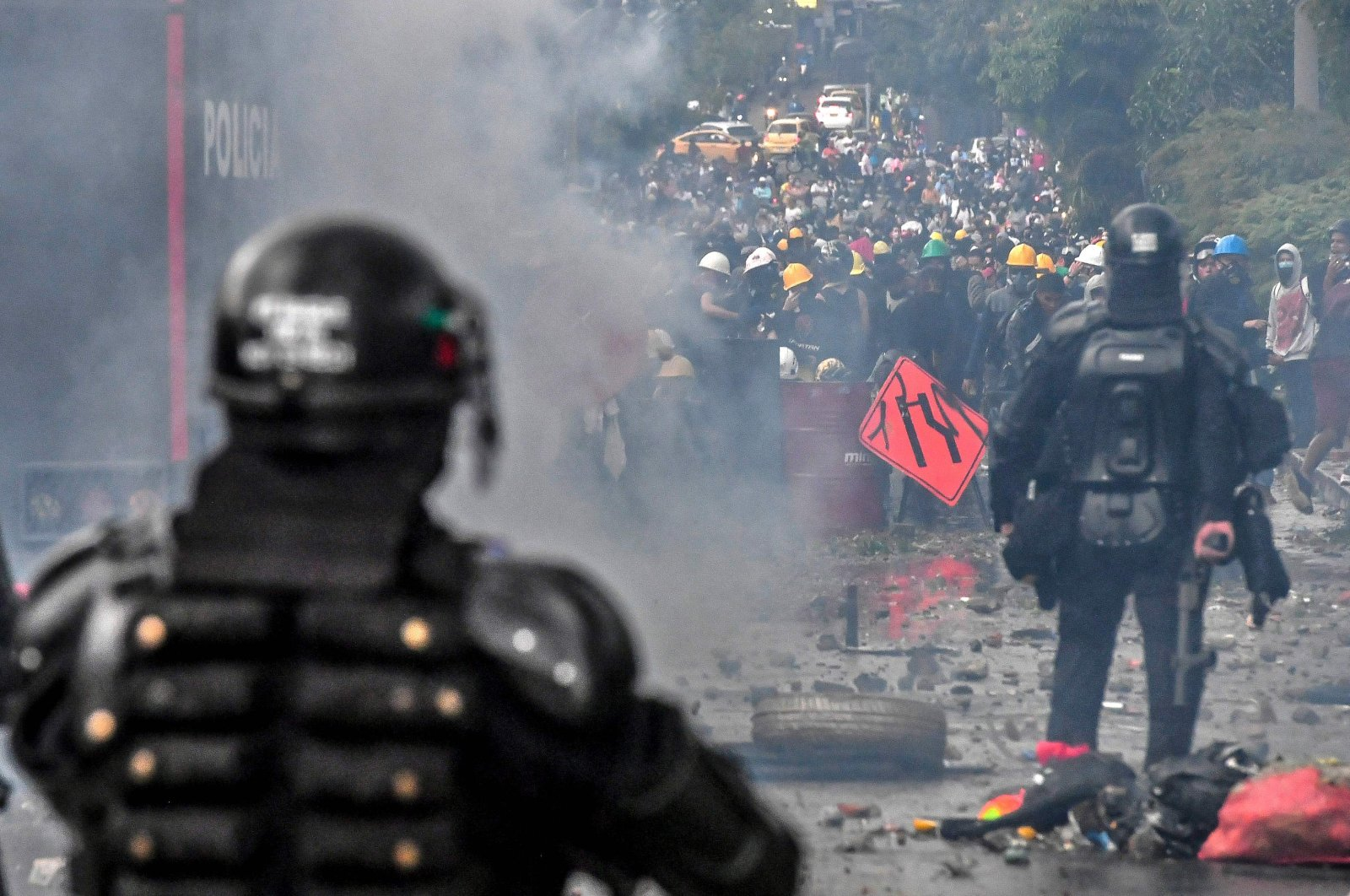 Riot police clash with demonstrators in a new protest against the government of Colombian President Ivan Duque in Medellin, Colombia, on June 2, 2021. (AFP Photo)