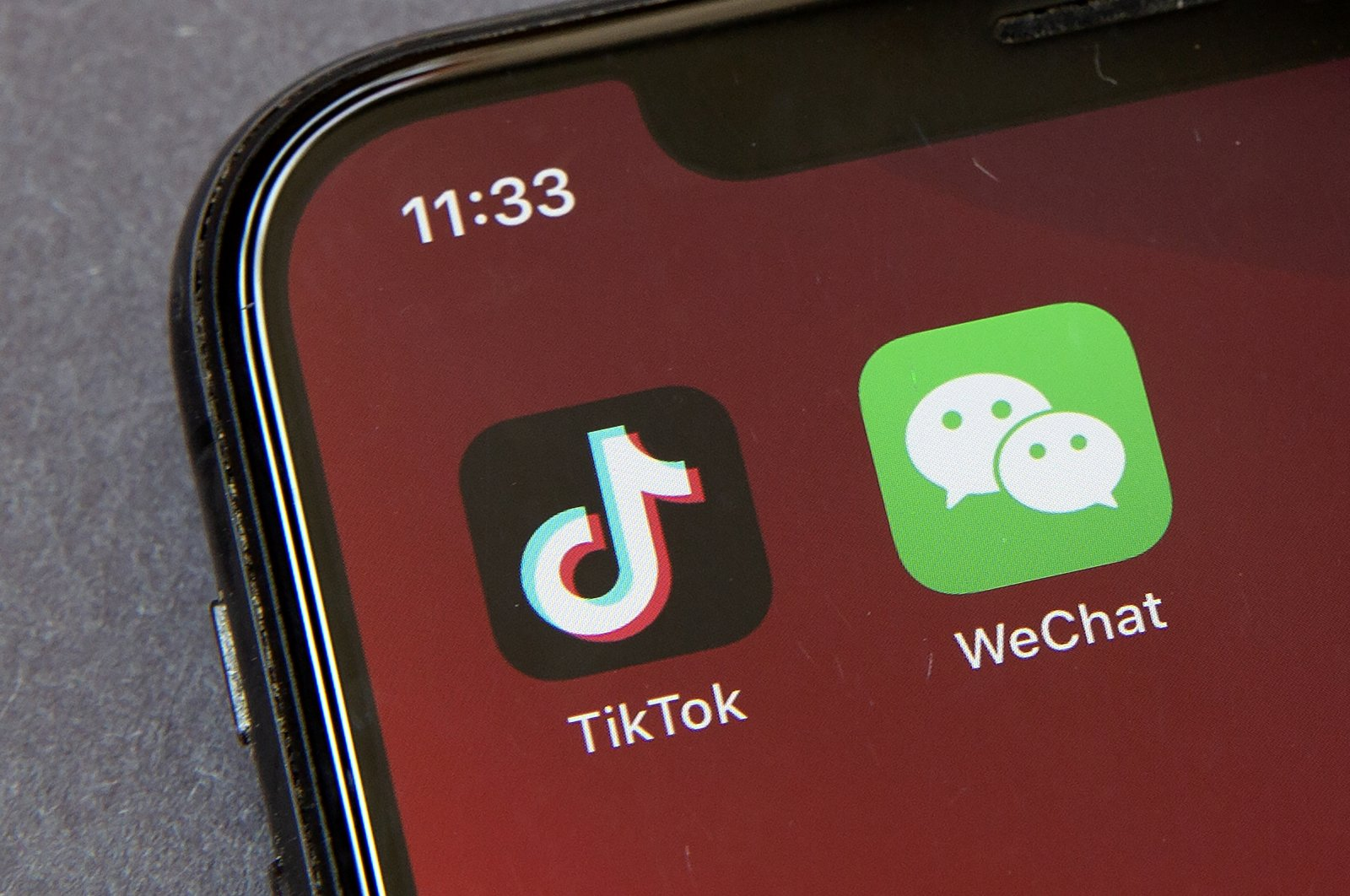 Icons for the smartphone apps TikTok and WeChat are seen on a smartphone screen in Beijing, China, Aug. 7, 2020. (AP Photo)