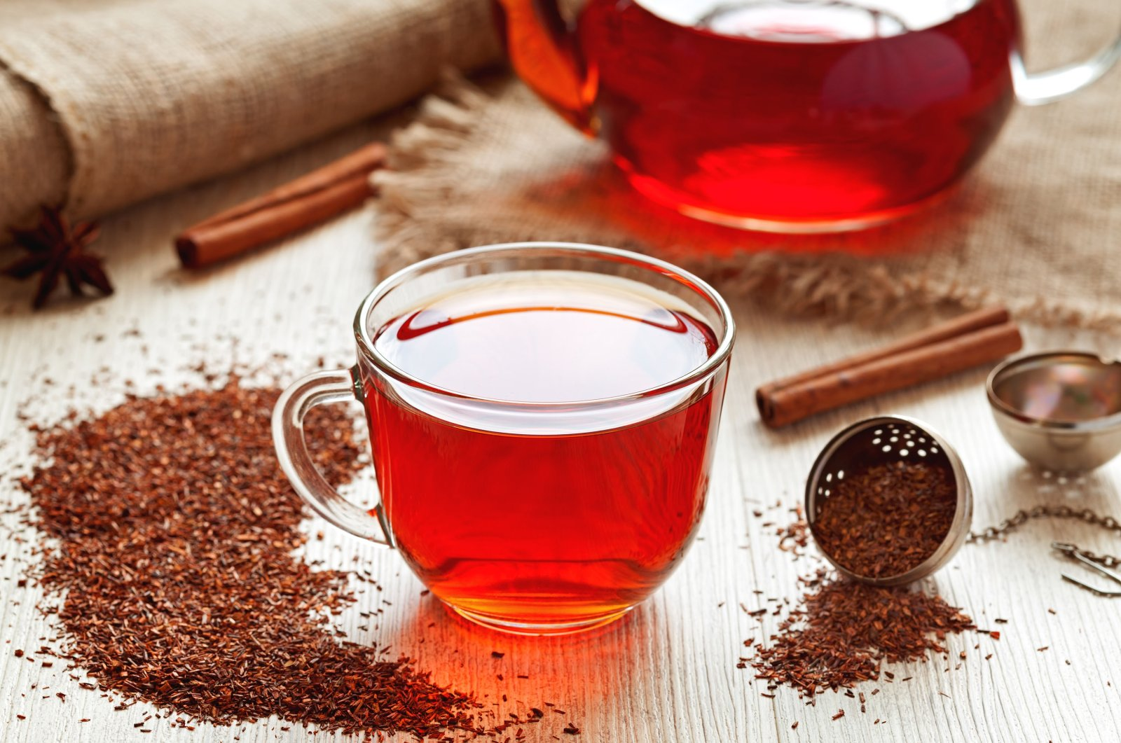 A cup of healthy traditional herbal rooibos tea with spices on a vintage wooden table. (Shutterstock Photo)
