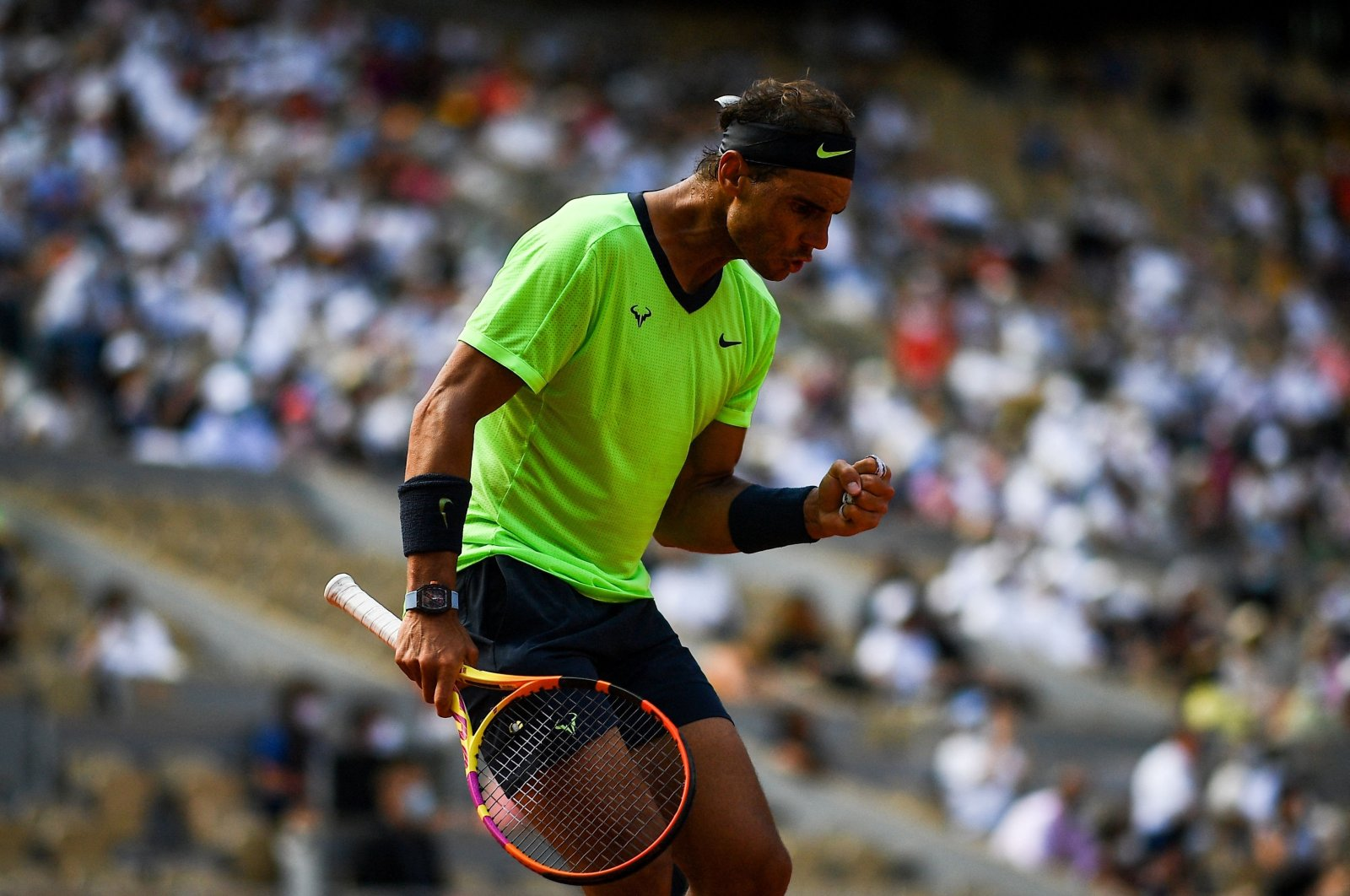 Spain's Rafael Nadal reacts as he plays against Argentina's Diego Schwartzman during their men's singles quarterfinal tennis match on Day 11 of The Roland Garros 2021 French Open tennis tournament in Paris, France, on June 9, 2021. (AFP Photo)
