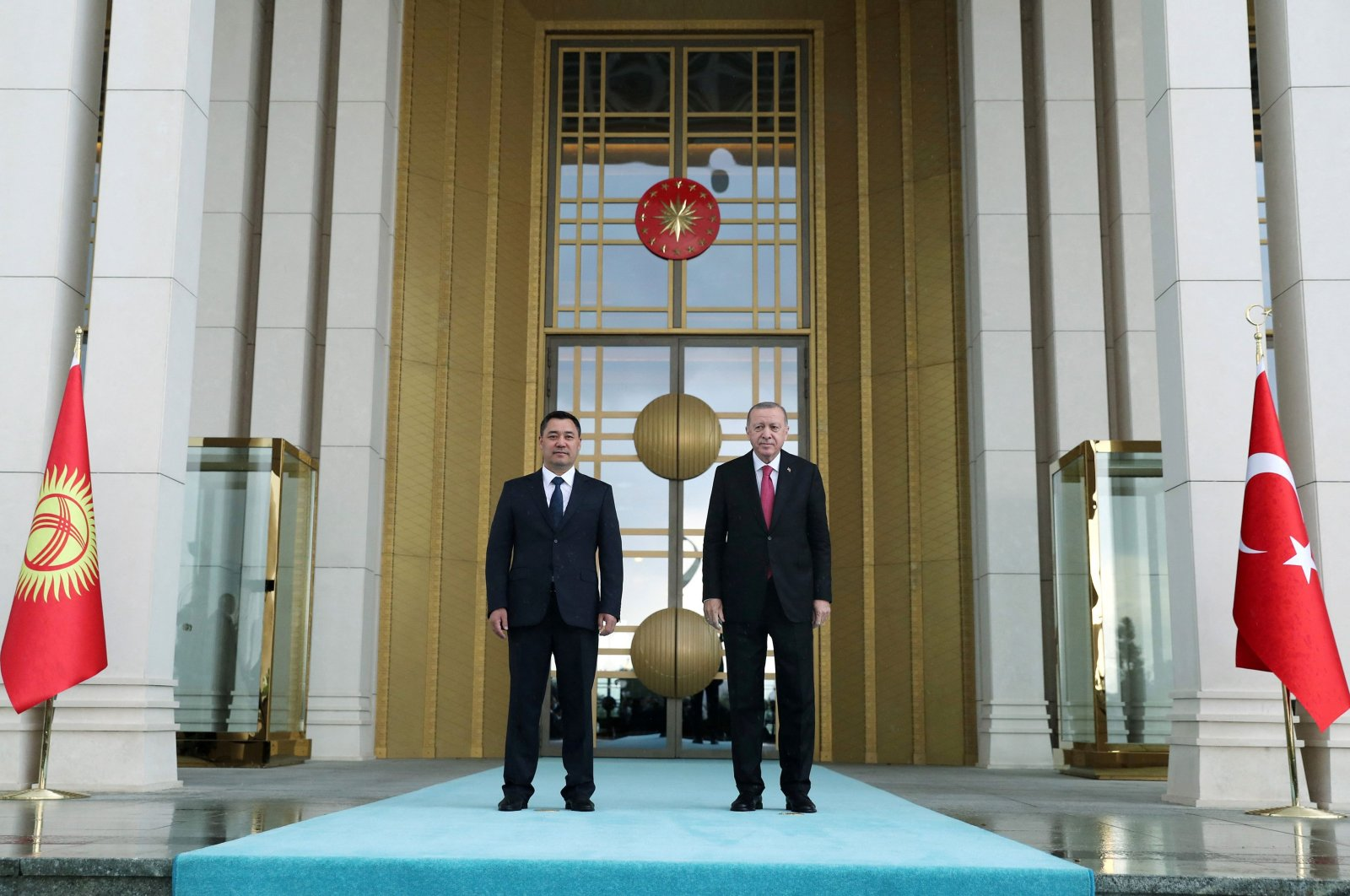 This handout picture released by the Turkish Presidential Press Service shows Turkish President Recep Tayyip Erdoğan (R) posing next to his Kyrgyz counterpart Sadyr Zhaparov (L) during an official ceremony at the Presidential Complex in Ankara, Turkey, June 9, 2021. (AFP Photo)