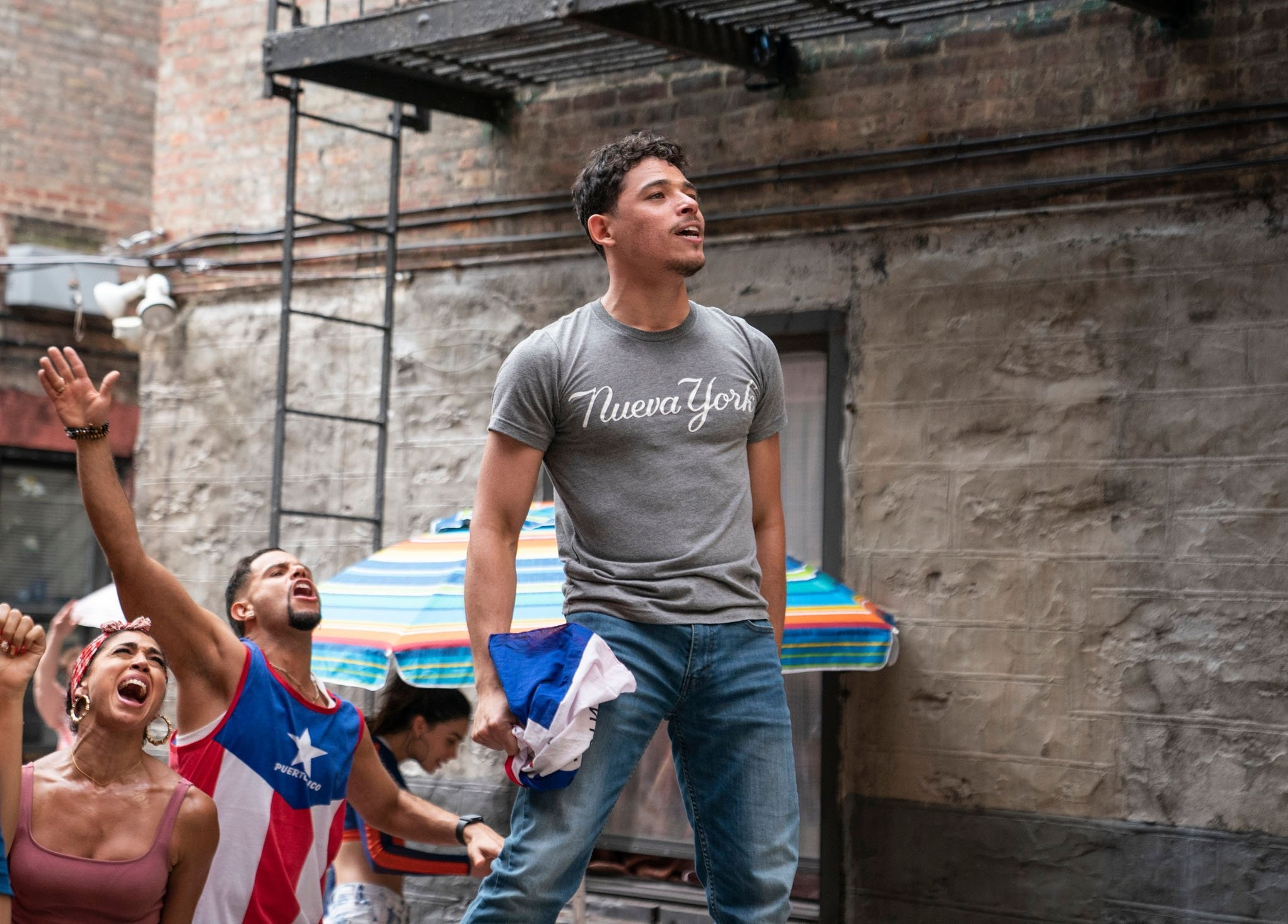 Actor Anthony Ramos (C) stands on high groundin a scene from the musical film 'In the Heights.' (Warner Bros. via AP)