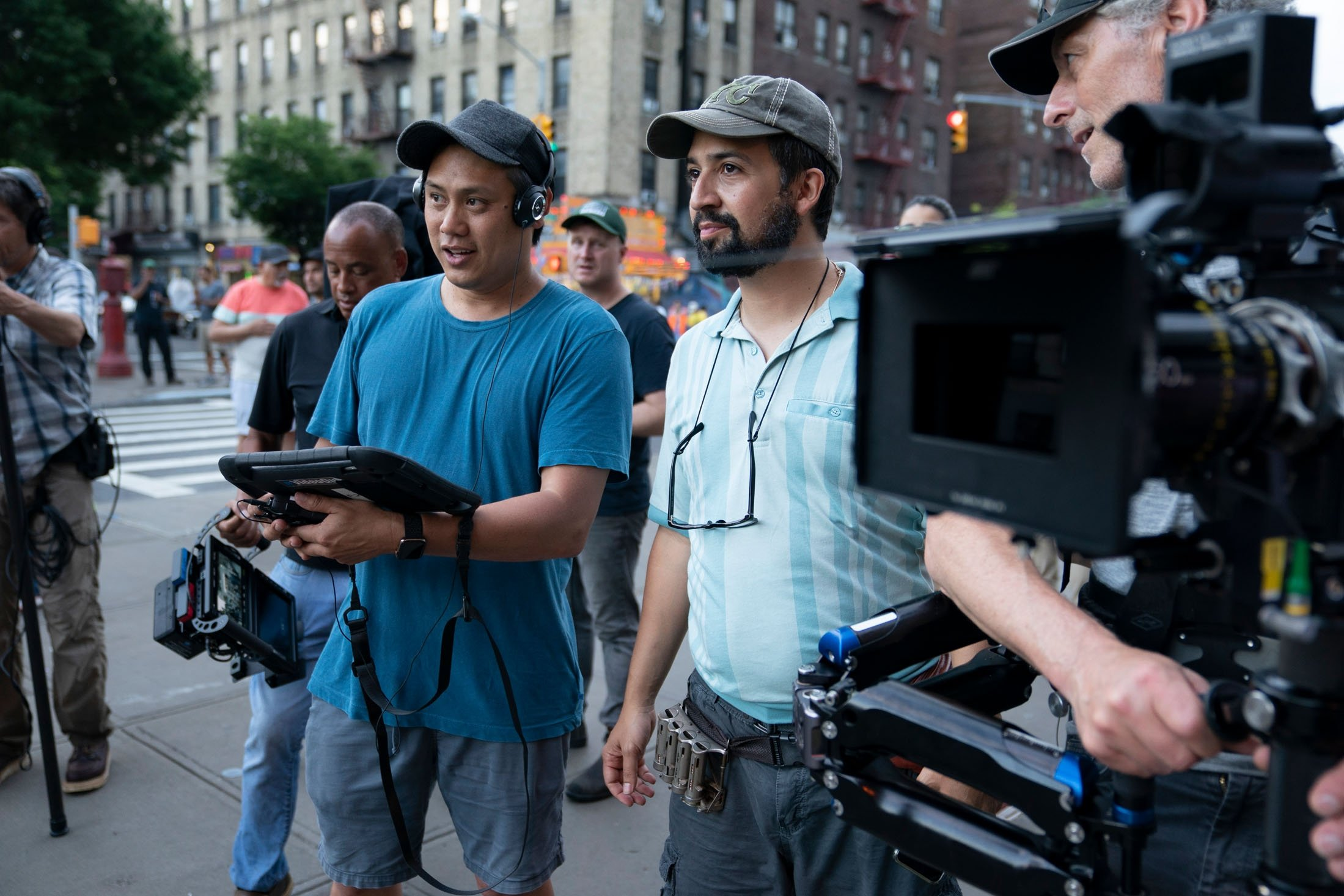 Director Jon M. Chu (L) and Lin-Manuel Mirandahave a conversation during the filming of the musical movie 'In the Heights.' (Warner Bros. via AP)