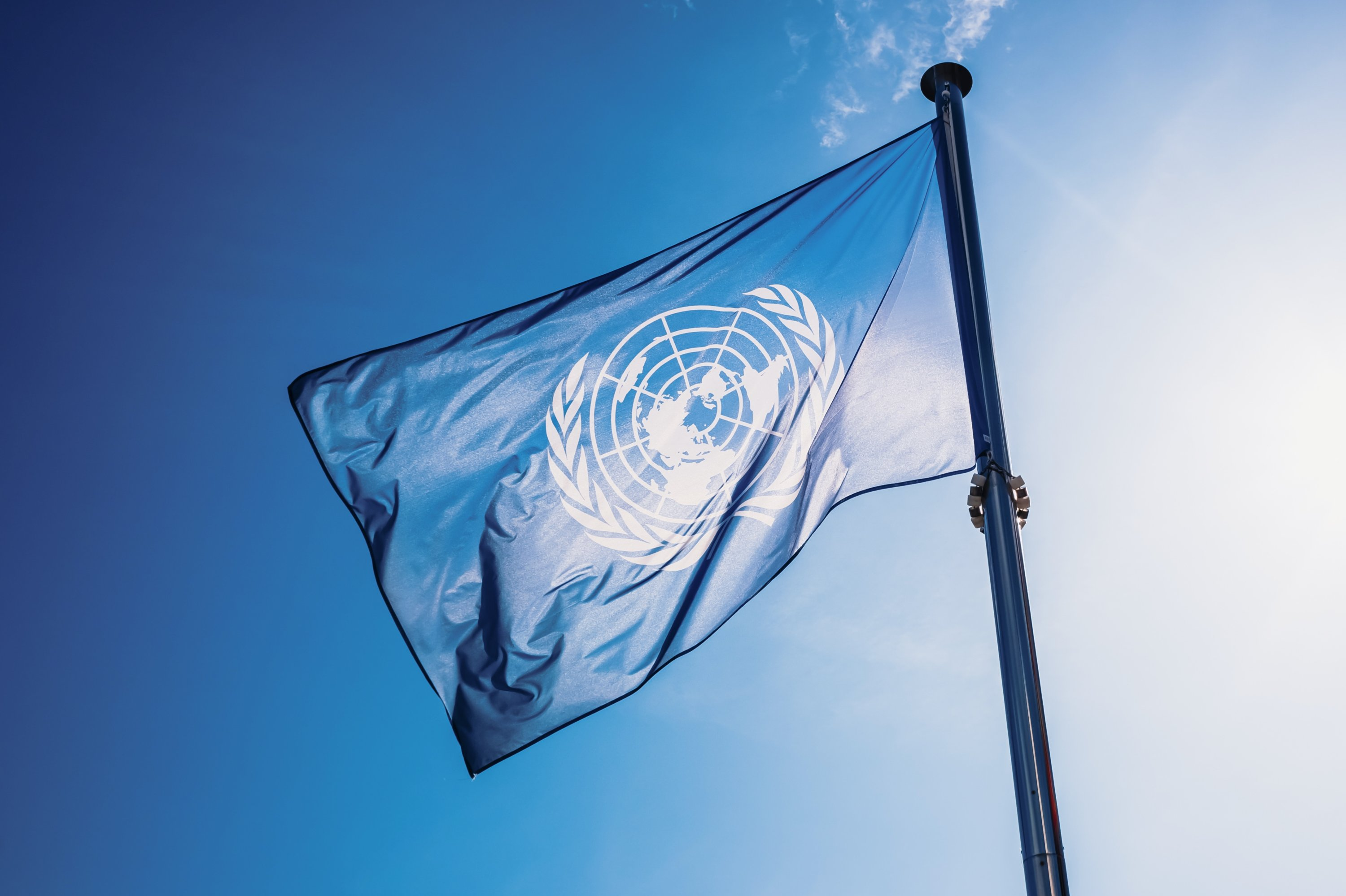 The United Nations flag waves in the sky, Valencia, Spain, Nov. 2, 2019. (Photo by Shutterstock)