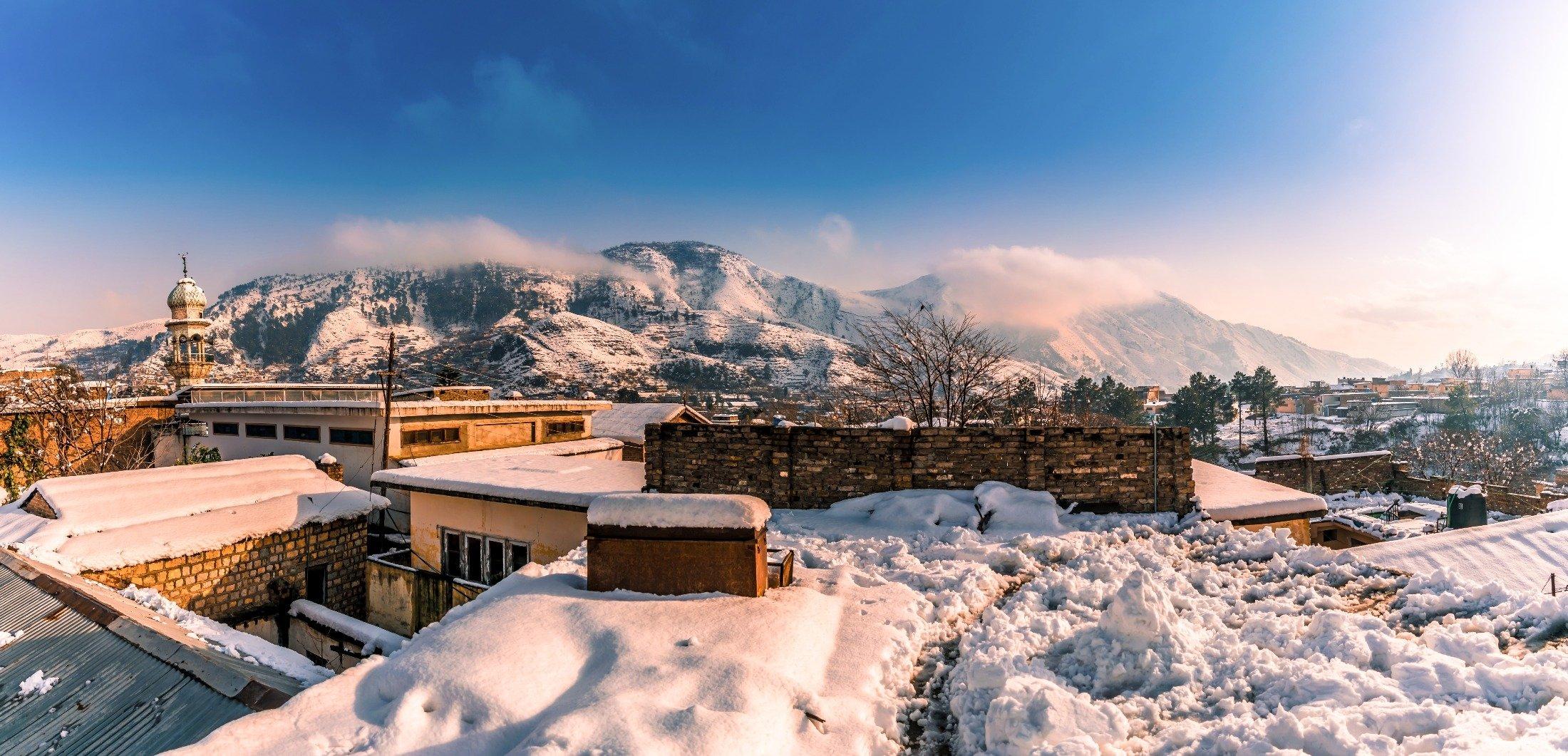 Sun shines on heavy snowfall in Abbottabad, Pakistan. (Shutterstock Photo)
