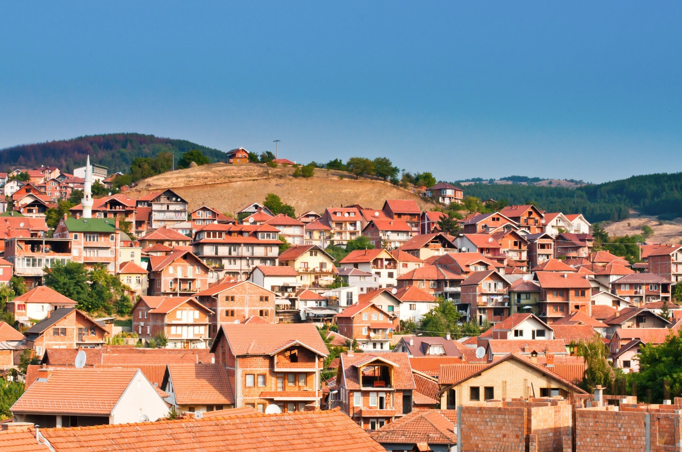 A general view shows the historical buildings and the minaret of a mosque in Novi Pazar, Serbia. (Shutterstock Photo)