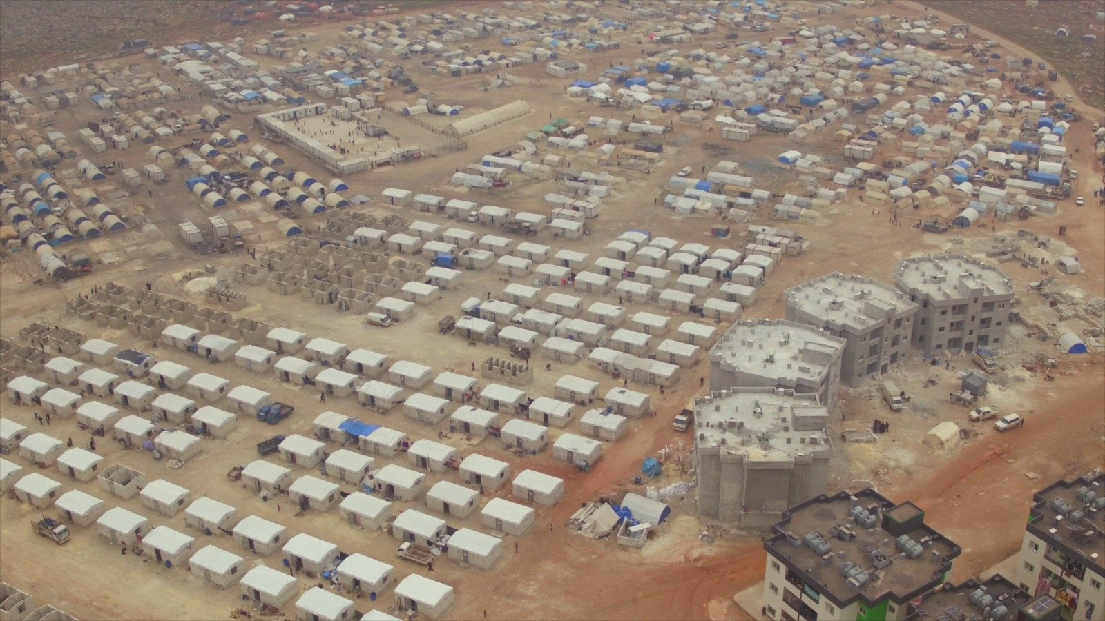 """As part of the """"Bağcılar Neighborhood"""" project,the construction of 450 briquette houses was completed in northwestern Syria's Idlib, June 10, 2021. (AA Photo)"""