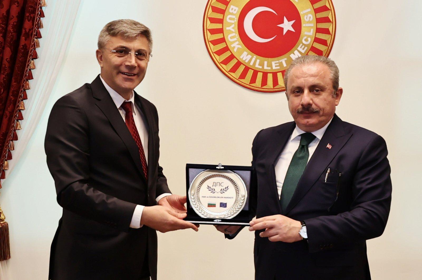 Turkish Parliament Speaker Mustafa Şentop (R) holds a plaque with MRF Party chair Mustafa Karadayı in Ankara, Turkey, June 5, 2021. (AA Photo)