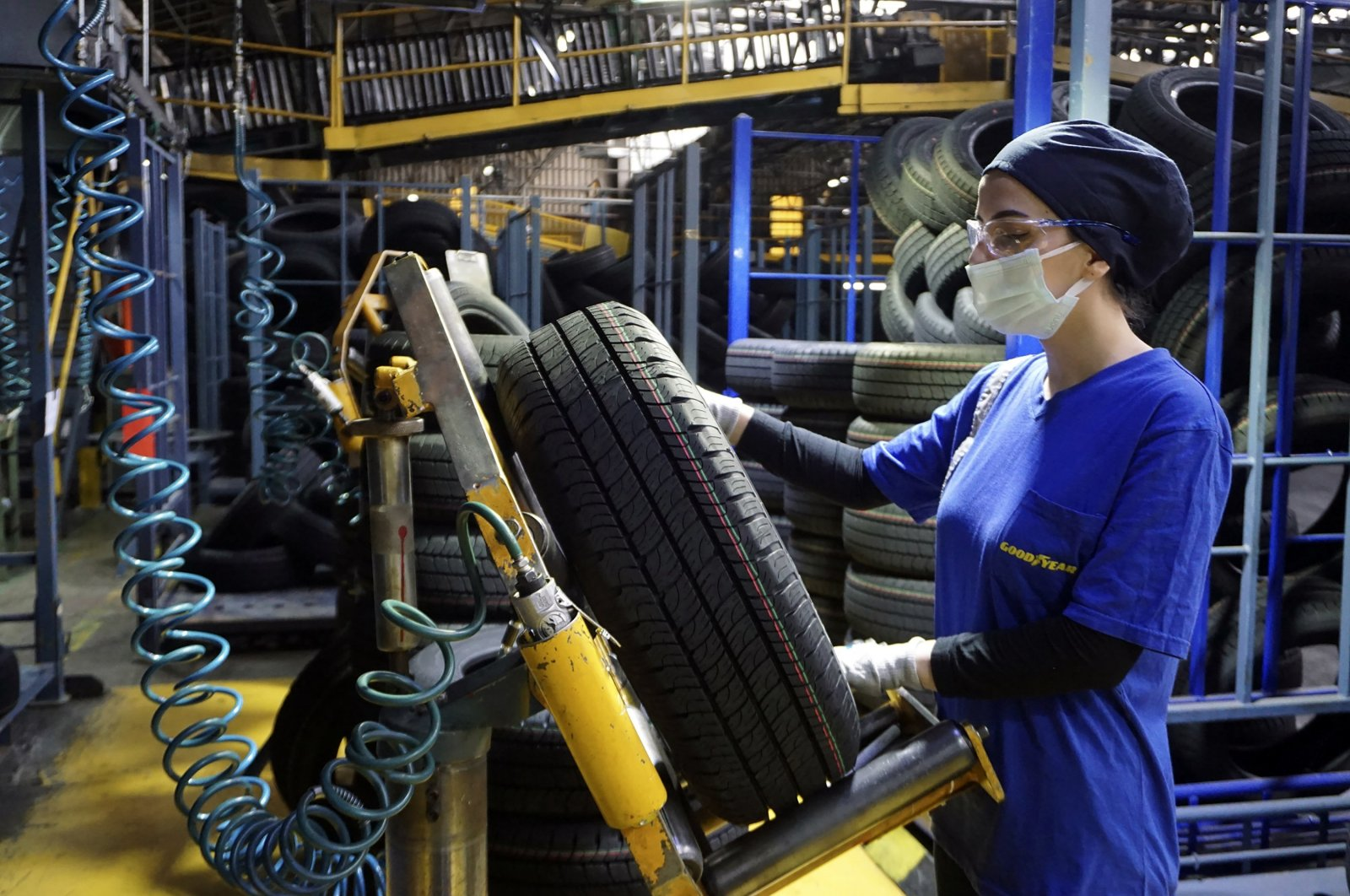 A woman working in the quality control department of the Goodyear factory checks a tire in the plant in Turkey's Sakarya province, June 1, 2021. (Sabah Photo)