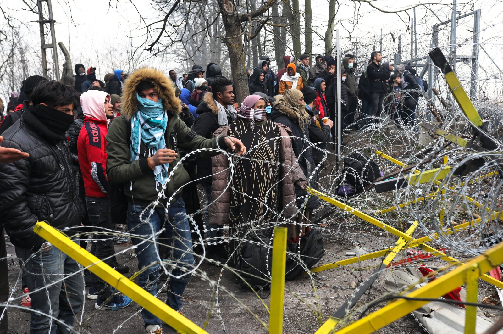 Migrants trying to communicate with Greek soldiers at the Turkish-Greek border, at Pazarkule Border Crossing in Edirne, Turkey, Feb. 29, 2020. (Getty Images)