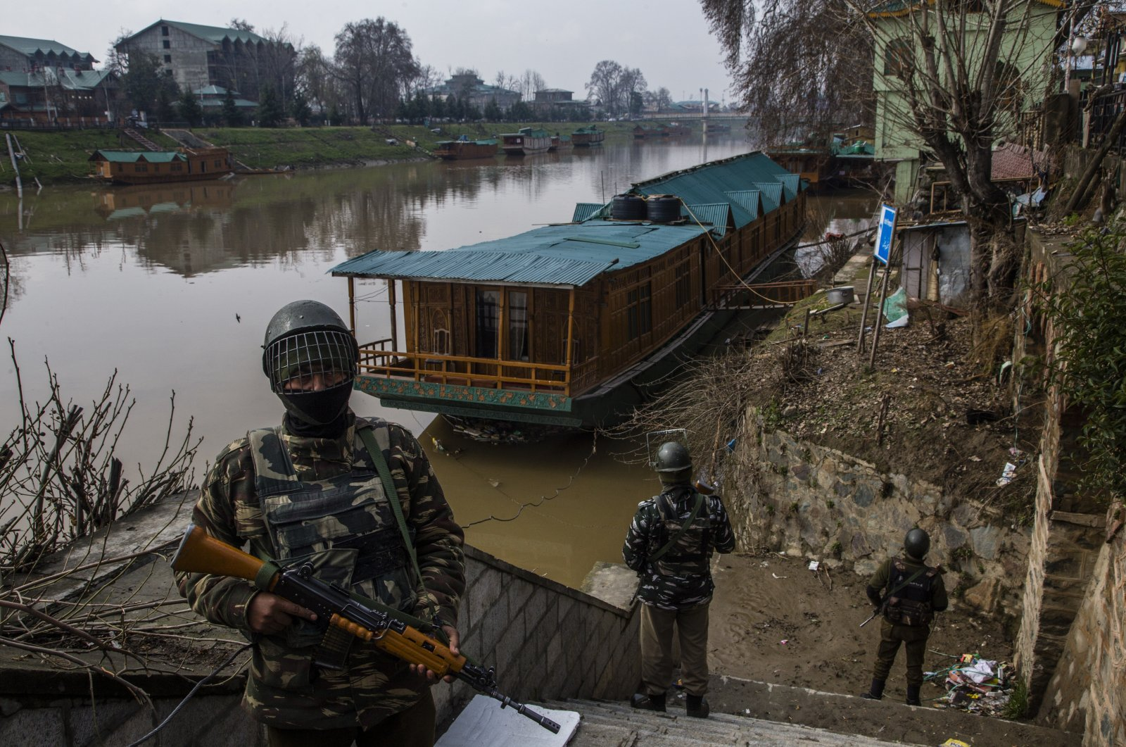 Indian forces stand guard on the bank of the Jehlum river, in Srinagar, Indian-administered Kashmir, March 15, 2021. (Photo by Getty Images)