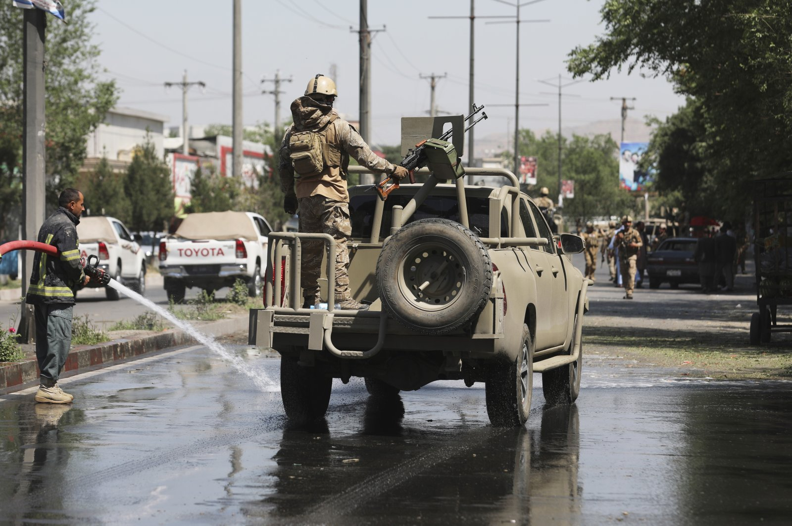 Afghan security personnel leave the scene of a roadside bomb explosion in Kabul, Afghanistan, June 6, 2021. (AP Photo)