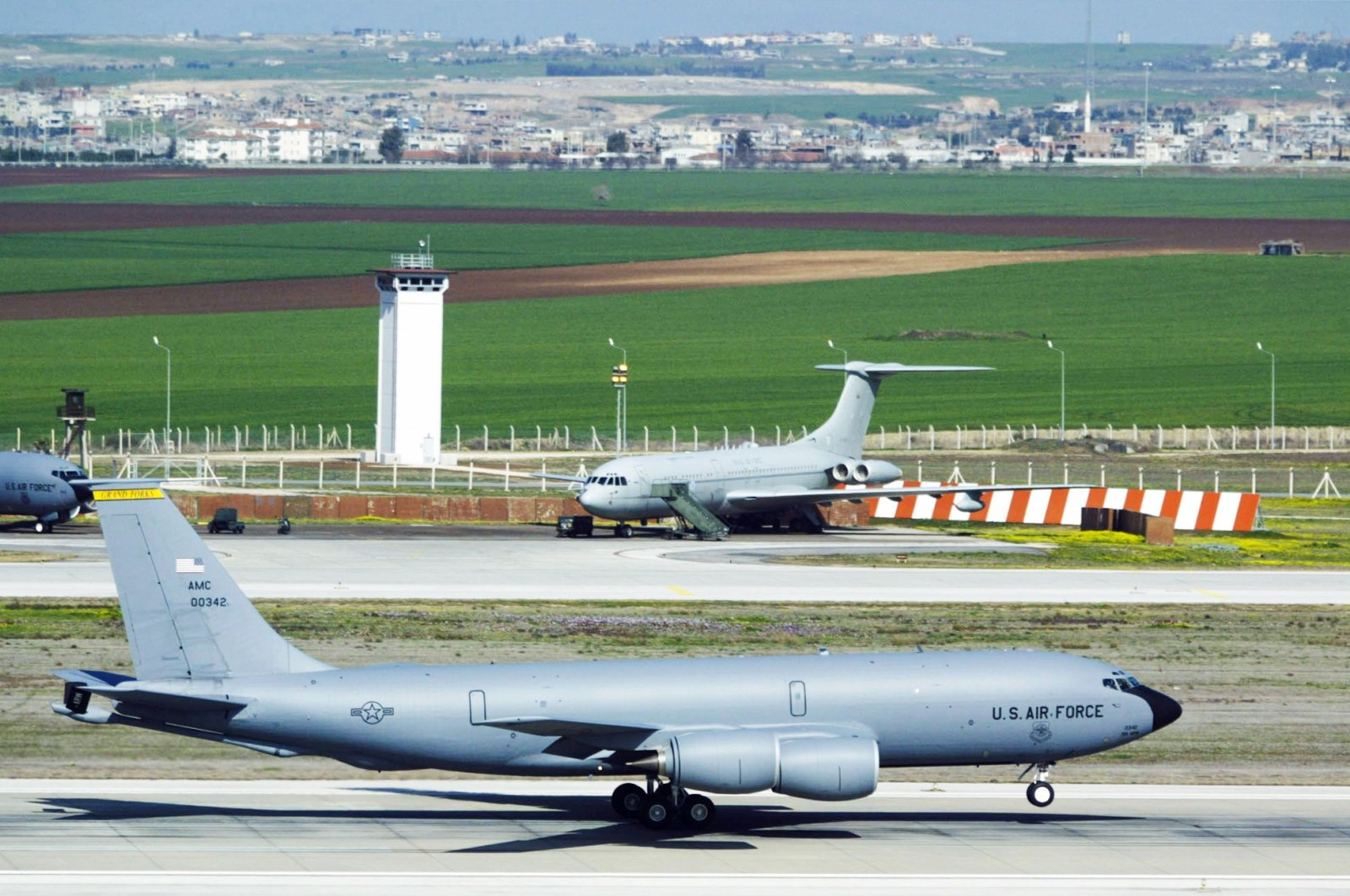A KC-135 refueling jet slides in front of a control tower during takeoff at Incirlik Air Force Base in Turkey, March 7, 2003. (Getty Images)
