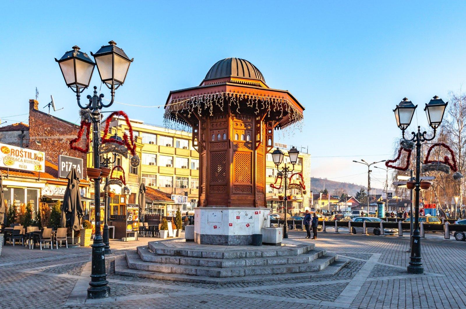 A replica of the historical Ottoman wooden Sebilj Fountain from Sarajevo, stands in Novi Pazar, Serbia. (Shutterstock Photo)