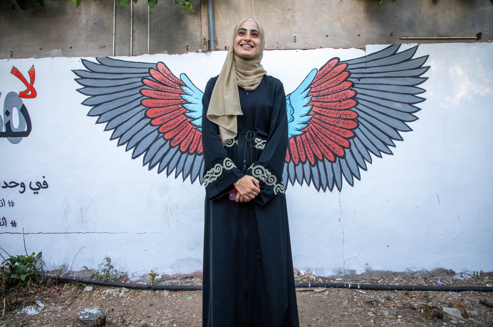 Muna al-Kurd, a 23-year-old Palestinian activist, poses for a photo in Sheikh Jarrah, occupied East Jerusalem, Palestine, June 10, 2021. (AA Photo)
