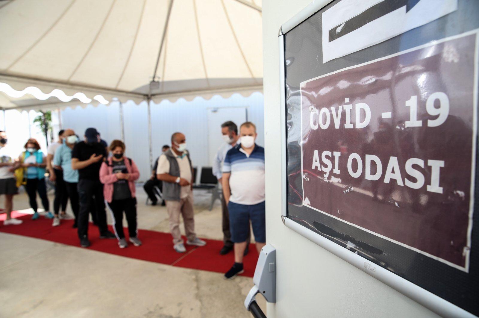 People wait for vaccinations at Professor Feriha Öz Emergency Hospital, in Istanbul, Turkey, June 10, 2021. (AA PHOTO)