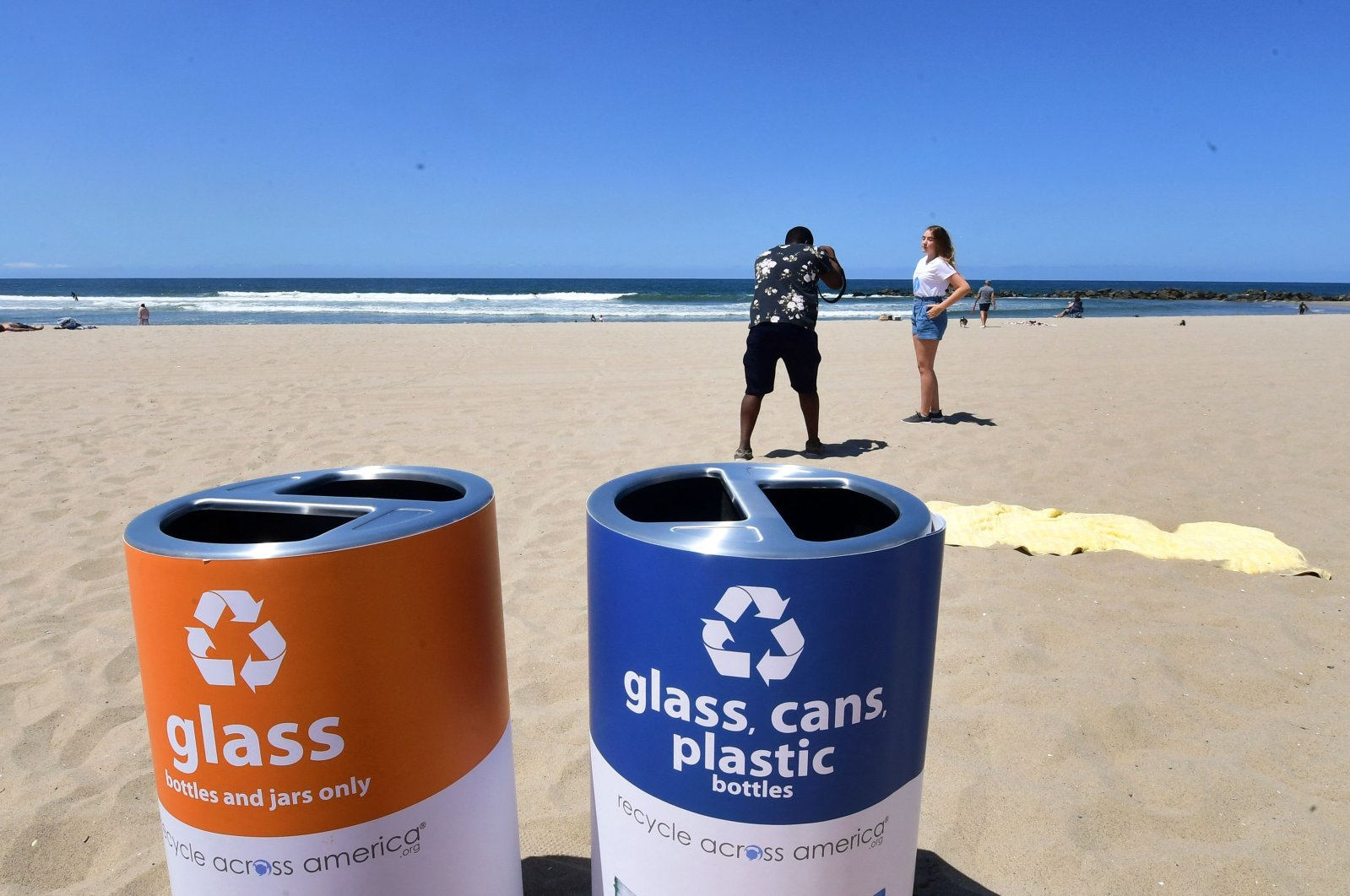 Separate containers for glass and for glass, cans and plastic sit at Venice Beach in Los Angeles, California, U.S, June 8, 2021. (AFP Photo)
