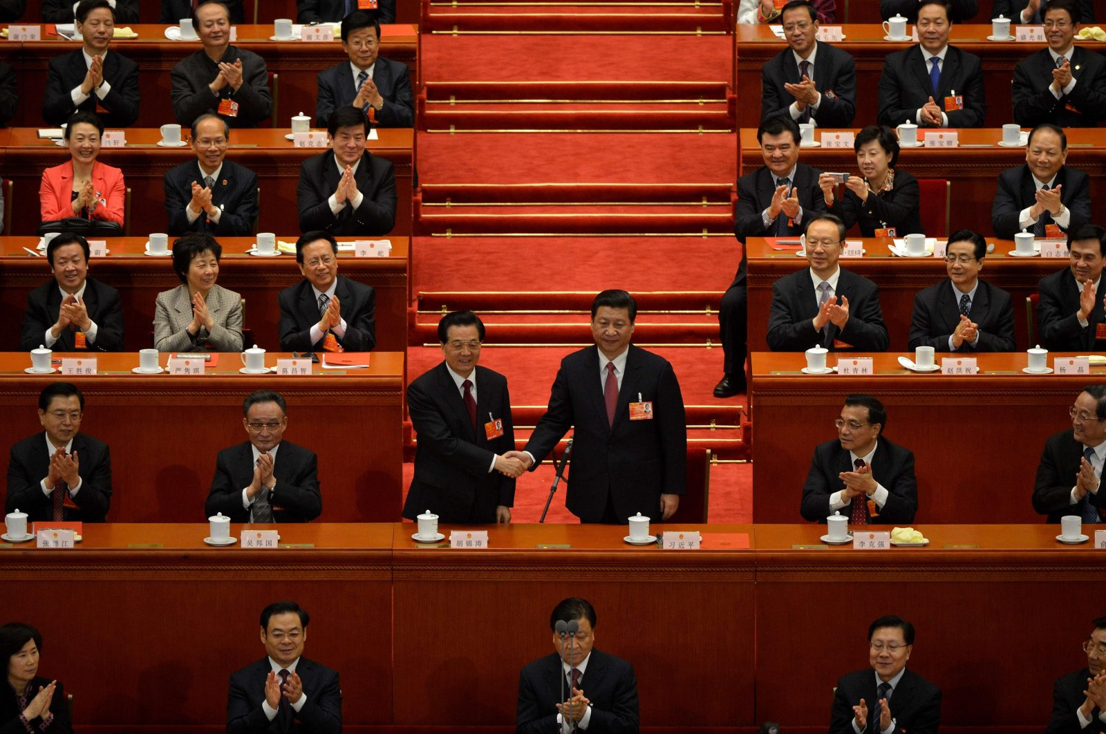 Former President Hu Jintao (L) and newly elected Chinese President Xi Jinping (R) shake hands after the election of the new president of China during the 12th National People's Congress (NPC) in the Great Hall of the People in Beijing, China, March 14, 2013. (AFP Photo)
