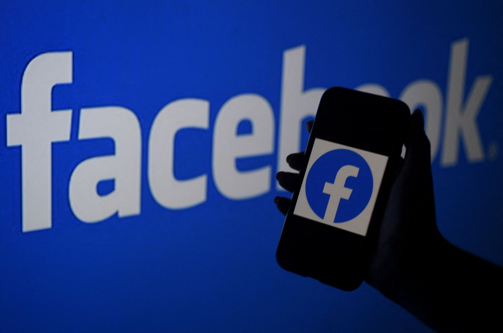 In this file photo illustration, a smart phone screen displays the logo of Facebook on a Facebook website background, in Arlington, Virginia, U.S., April 7, 2021. (AFP Photo)