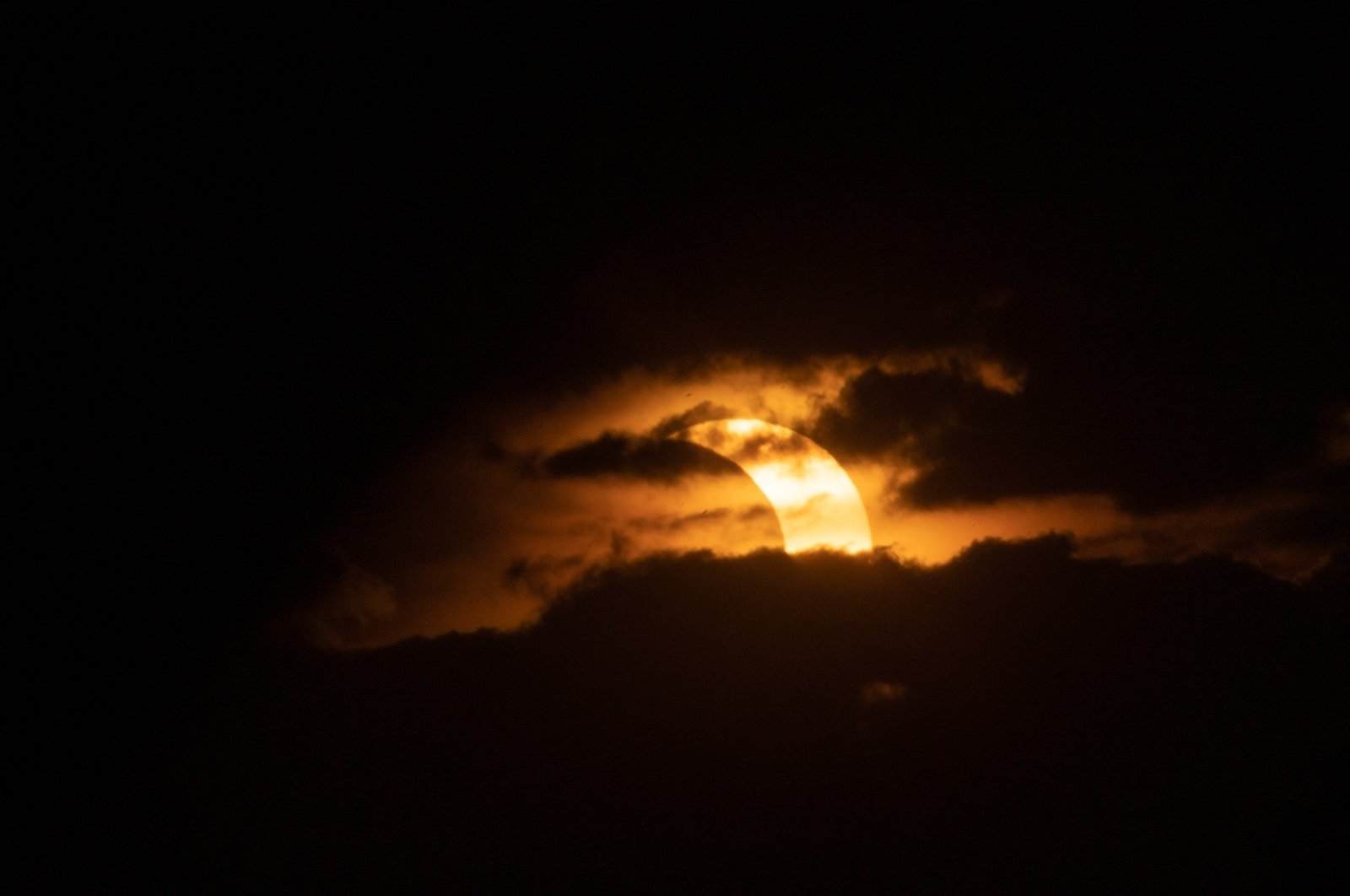 A eclipsed sun rises over Tobermory in Ontario, Canada, June 10, 2021. (AFP Photo)