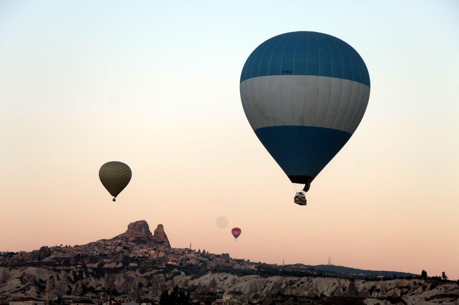 Hot air balloons rise one by one over the skies of Cappadocia region, Nevşehir, central Turkey, June 10, 2021. (IHA Photo)