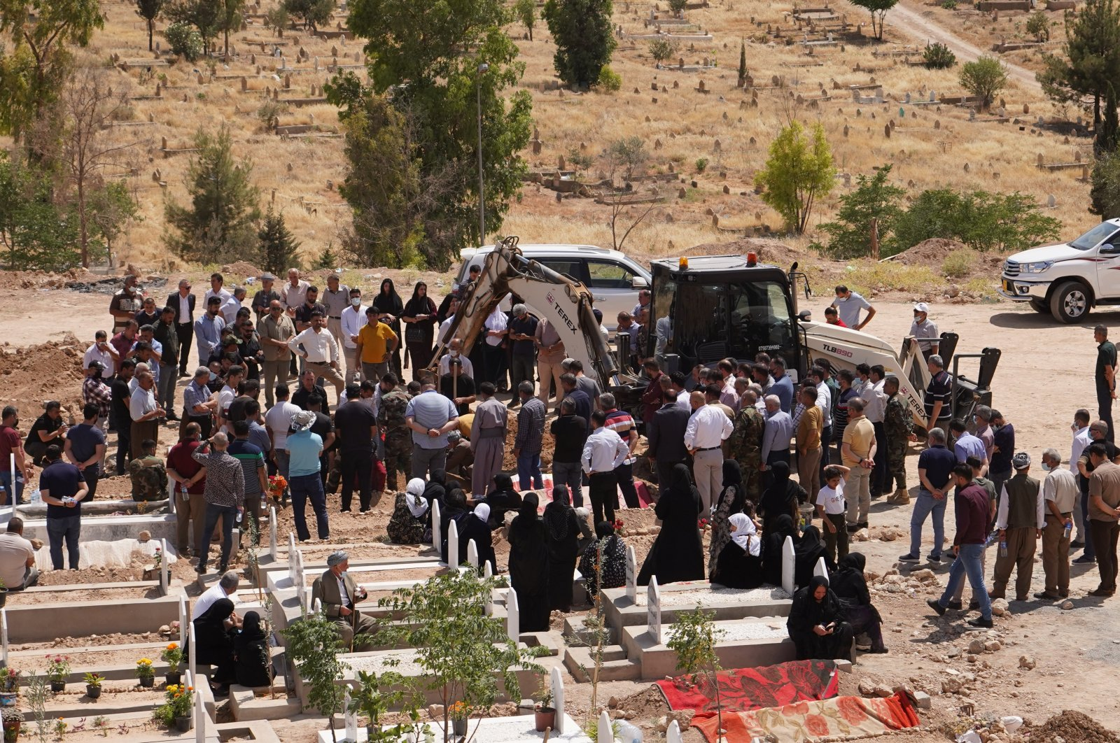 A funeral ceremony was held for a Peshmerga soldier killed by PKK terrorists in northern Iraq's Duhok, June 10, 2021. (AA Photo)