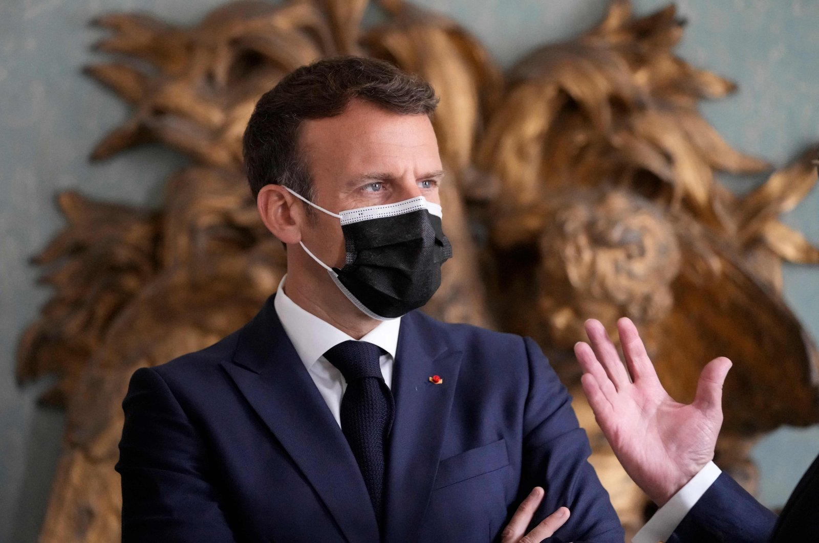 French President Emmanuel Macron listens to a presentation during the inauguration of the Hotel de La Marine Museum in Paris, June 10, 2021. (AFP Photo)
