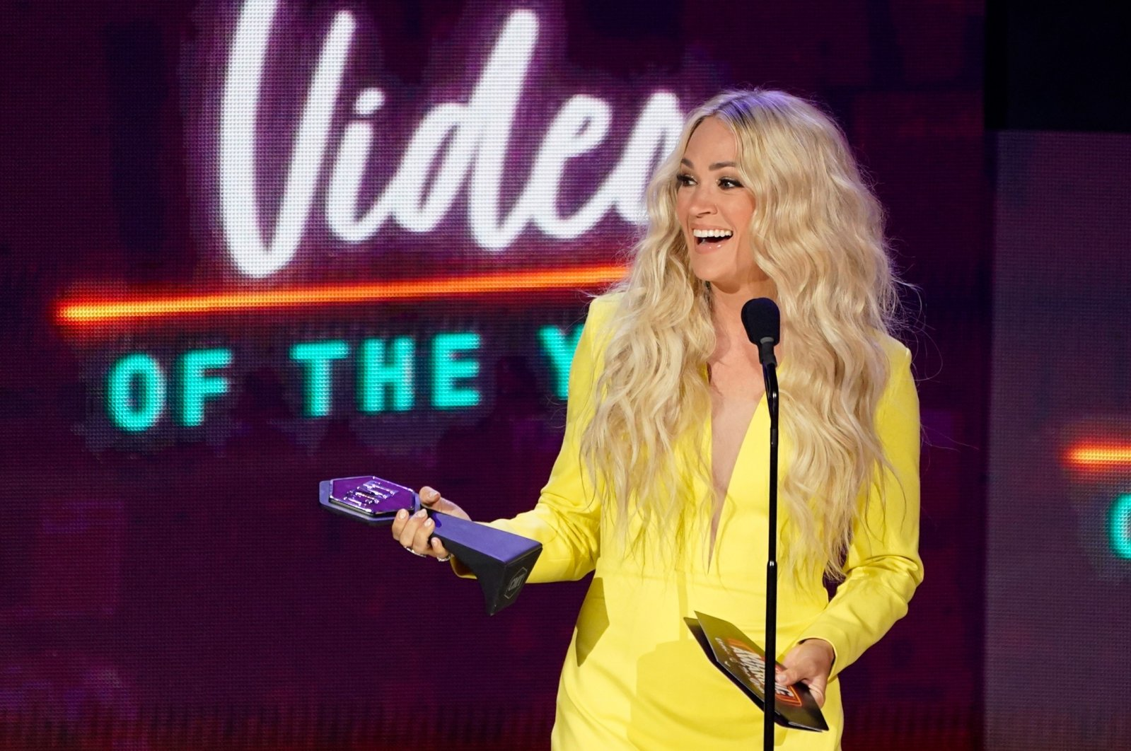 """Carrie Underwood accepts the award for video of the year for """"Hallelujah"""" at the CMT Music Awards at the Bridgestone Arena, in Nashville, Tennnessee, June 9, 2021. (AP Photo)"""