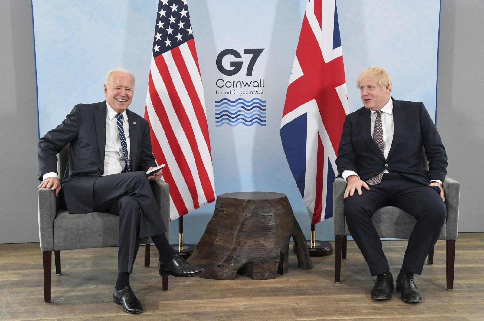 U.S. President Joe Biden (L) speaks with Britain's Prime Minister Boris Johnson during their meeting ahead of the G7 summit in Cornwall, Britain, Thursday, June 10, 2021. (AP Photo)