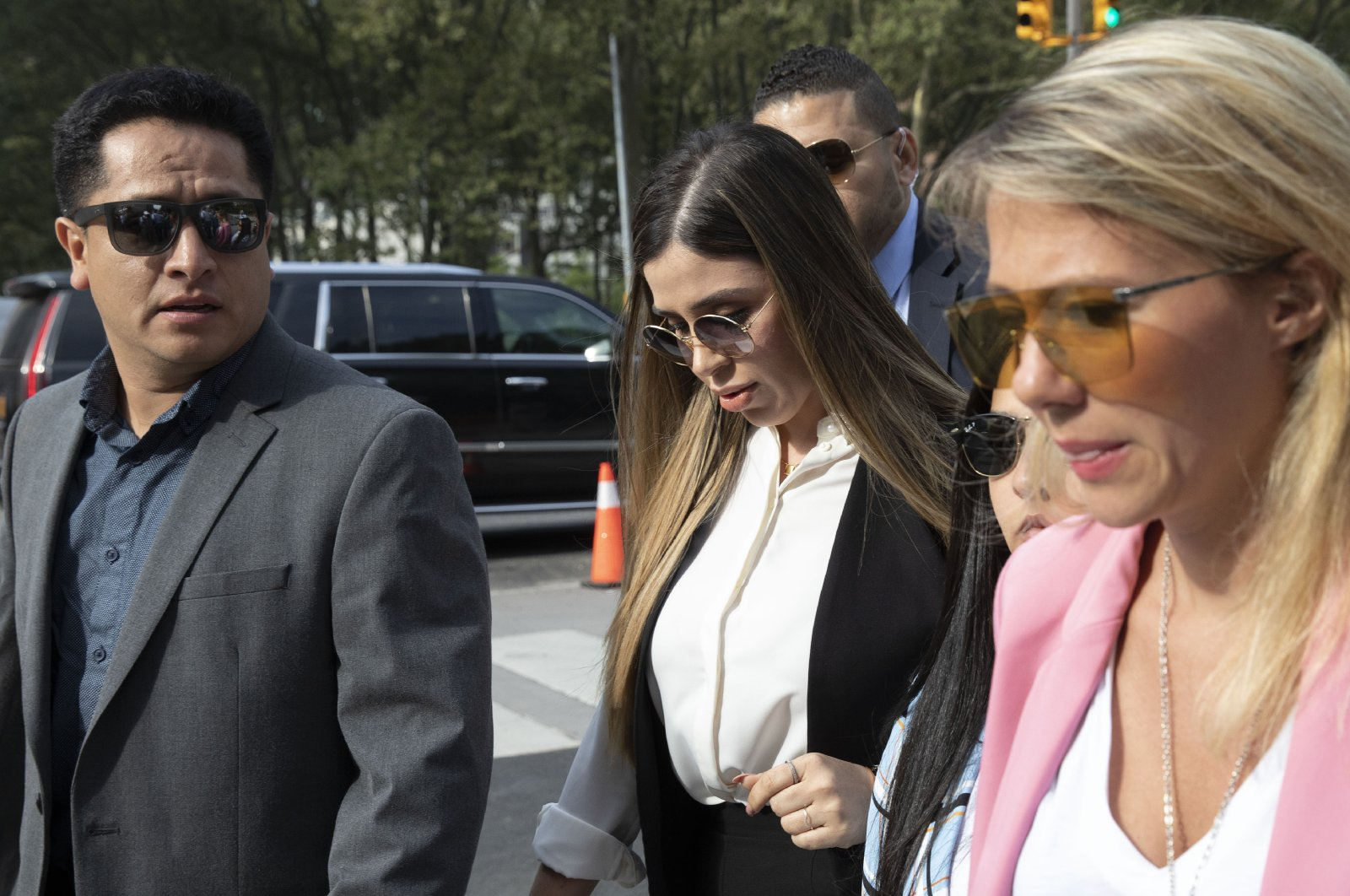 """Emma Coronel Aispuro (C) wife of Mexican drug lord Joaquin """"El Chapo"""" Guzman, arrives for his sentencing at Brooklyn federal court, in New York, July 17, 2019. (AP Photo)"""
