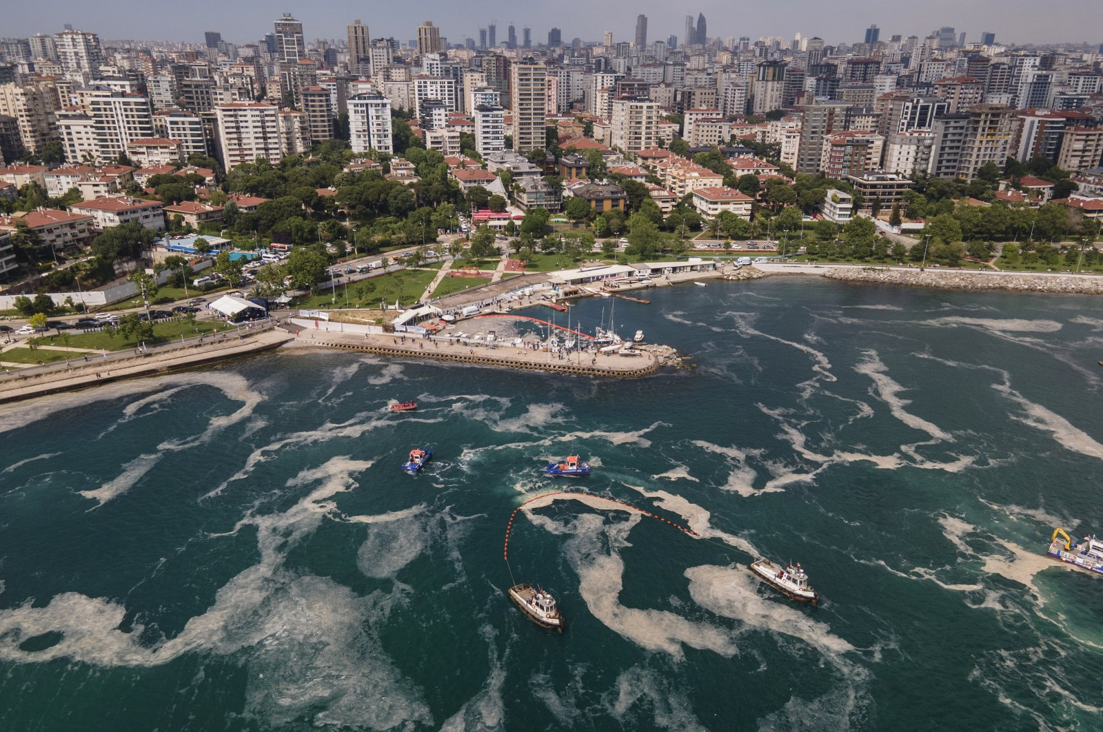 An aerial photo of the sea at the Caddebostan shore, on the Asian side of Istanbul, with a huge mass of marine mucilage, a thick, slimy substance made up of compounds released by marine organisms, in Turkey's Marmara Sea, June 8, 2021. (AP Photo)