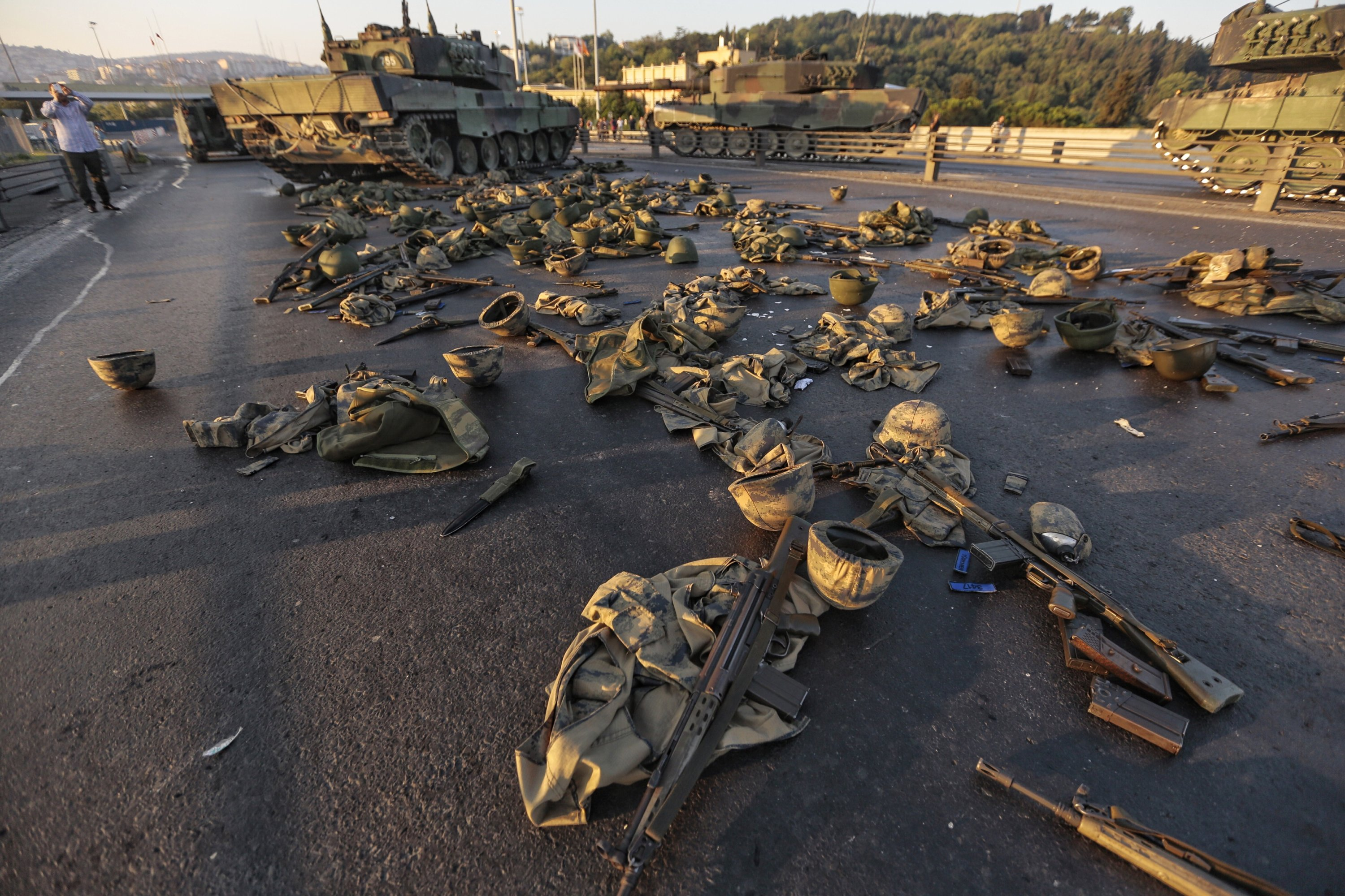 Clothes and weapons belonging to Gülenist Terror Group (FETÖ) soldiers involved in the coup attempt lie abandoned on the ground, on the Bosporus Bridge – now the July 15 Martyrs' Bridge – in Istanbul, Turkey, July 16, 2016. (Photo by Getty Images)