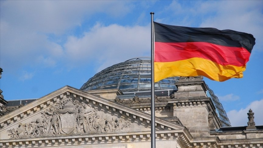 This file photo shows the German flag in front of the German parliament, also known as Bundestag, in the capital Berlin. (AA Photo)