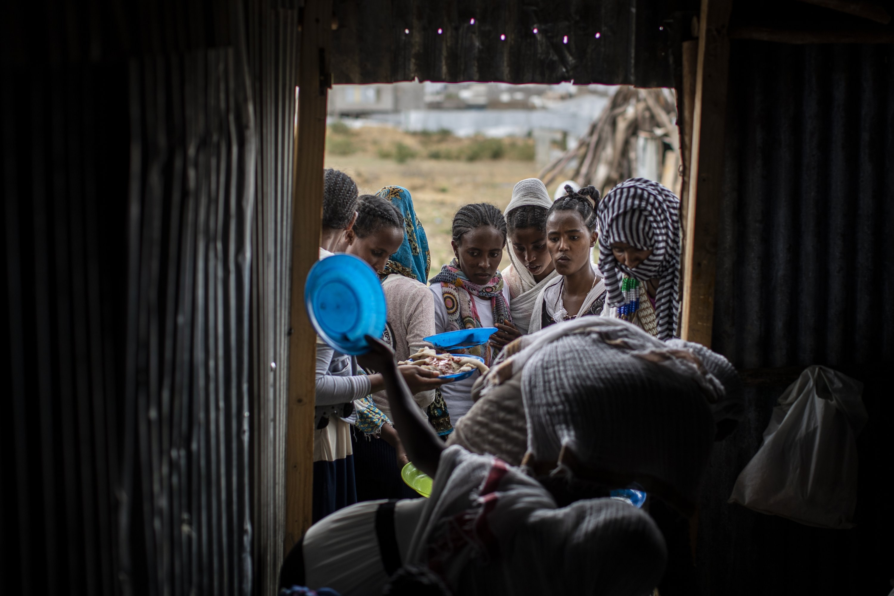 Tigrayans stand in line to receive food donated by local residents at a reception center for the internally displaced in Mekele, in the Tigray region of northern Ethiopia, May 9, 2021. (AP Photo)
