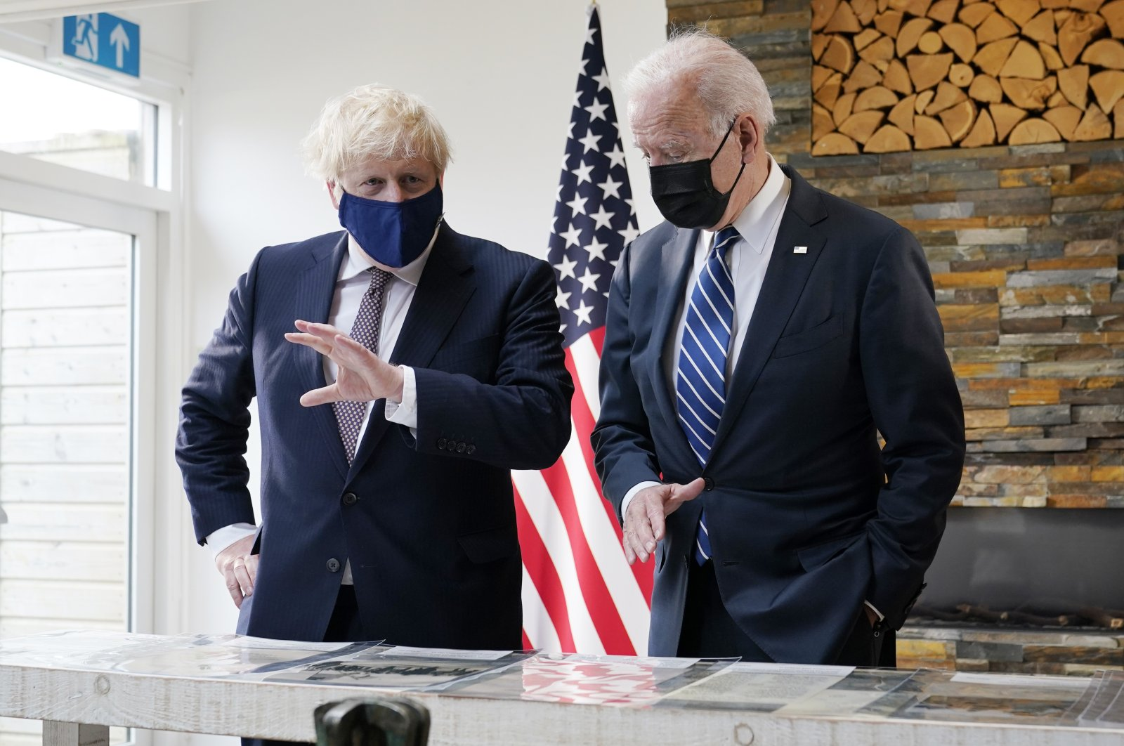 U.S. President Joe Biden and British Prime Minister Boris Johnson look at copies of the Atlantic Charter, during a bilateral meeting ahead of the G-7 summit, in Carbis Bay, England, June 10, 2021. (AP Photo)