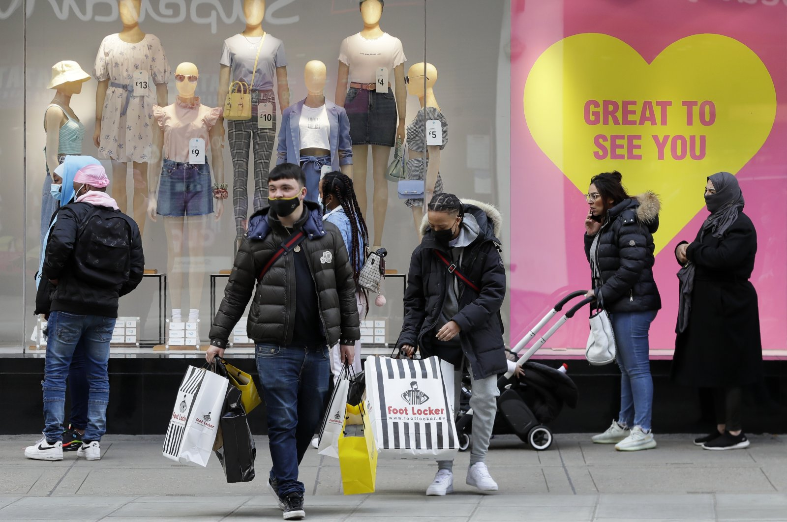 People queue to get into Primark store on Oxford Street in London, Britain, April 12, 2021. (AP Photo)