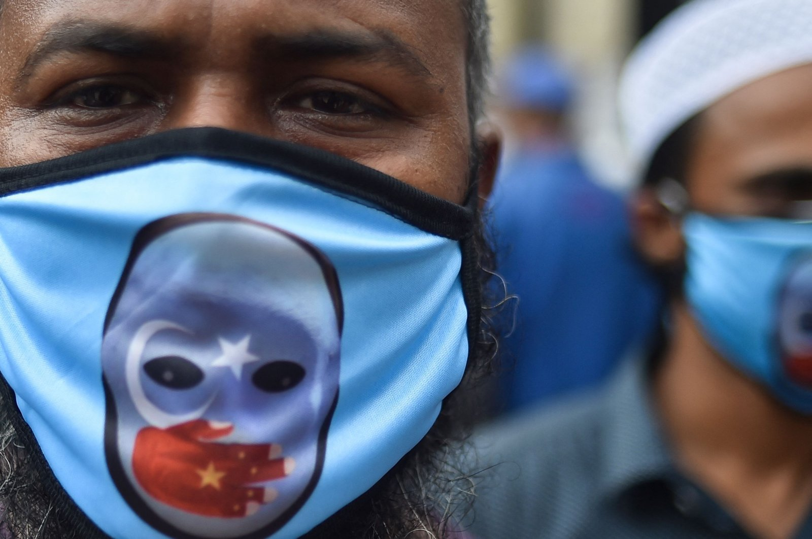 Activists from the political platform Sammilita Islami Oikya Jote stage a protest against the crackdown on Uyghurs in China and to mark the 32nd anniversary of the Tiananmen Square Massacre, in Dhaka, Bangladesh, June 4, 2021. (AFP Photo)