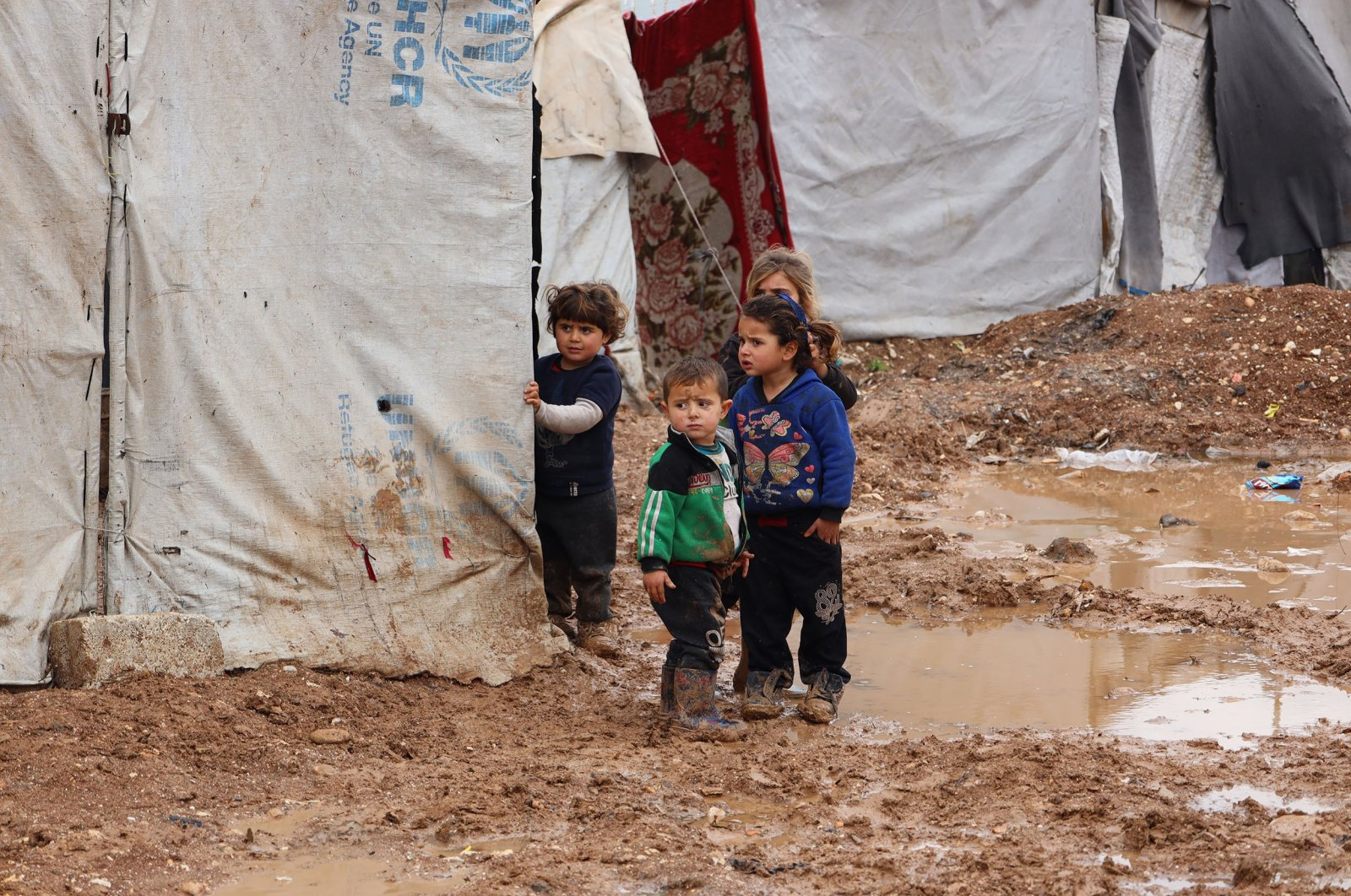 Syrian children stand outside tents in a camp for the displaced, near the Syrian-Turkish border, Syria, Jan. 29, 2021. (Getty Images)