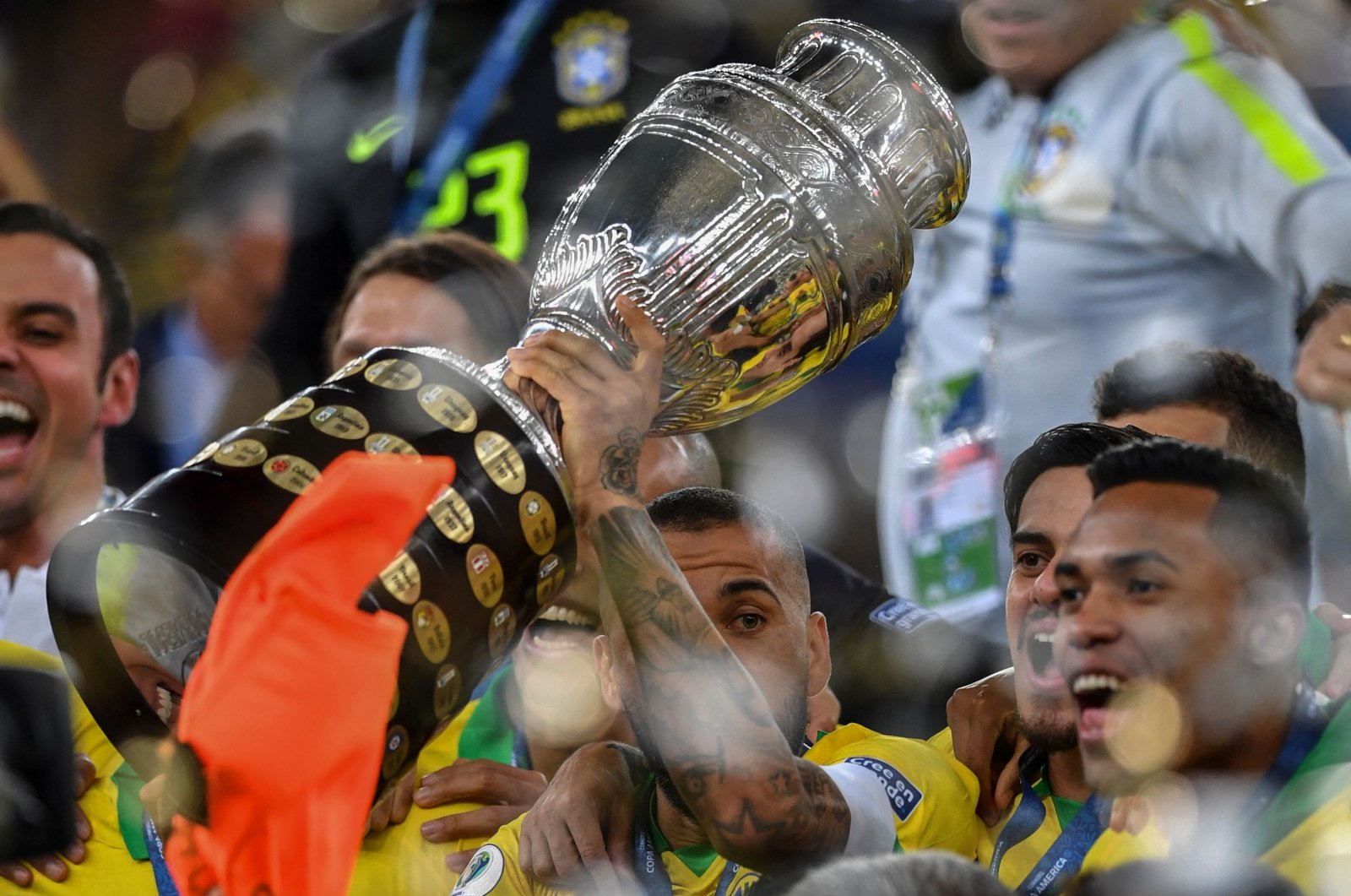 Brazil's Dani Alves holds up the Copa America trophy after defeating Peru in the final at Maracana Stadium in Rio de Janeiro, Brazil, July 07, 2019. (AFP Photo)