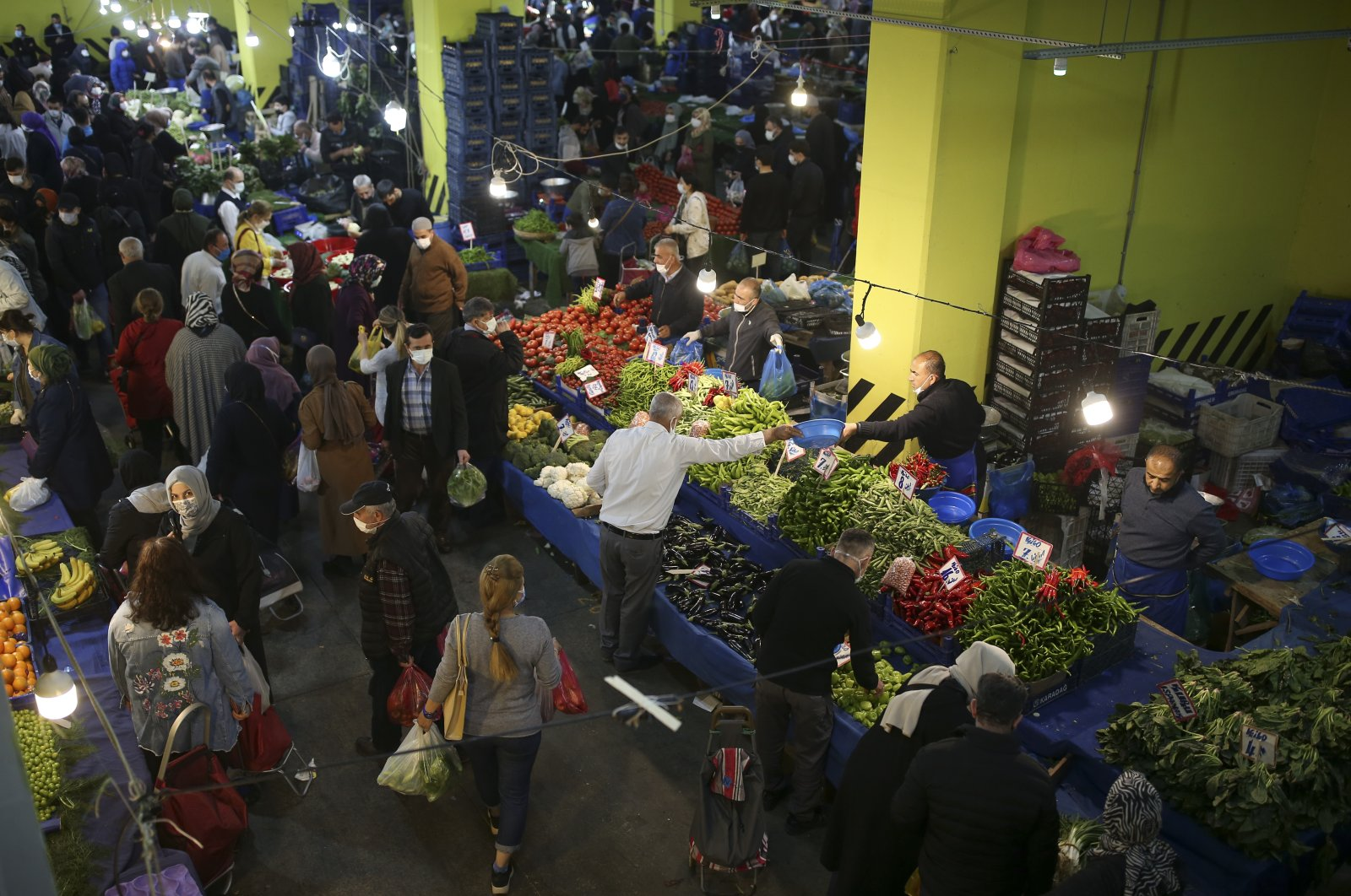 People shop at a local market in Istanbul, Turkey, April 29, 2021. (AP Photo)