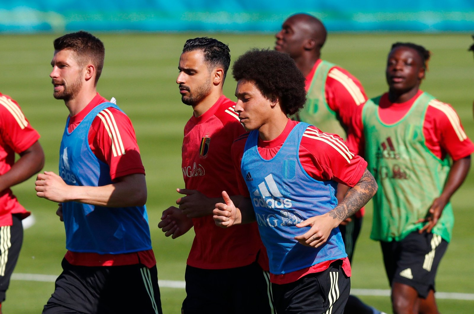 Belgium's Axel Witsel (R) and Nacer Chadli (C) with teammates during training, Tubize, Belgium, June 9, 2021. (Reuters Photo)