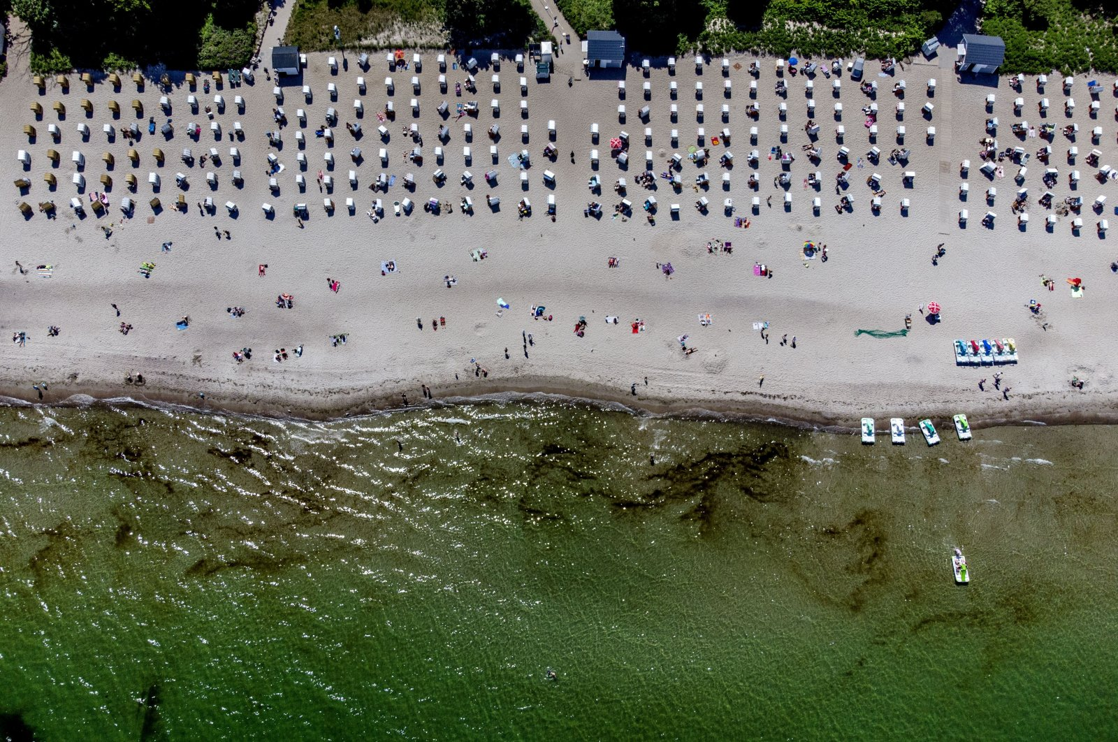 Tourists visit a beach on the Baltic Sea in Timmendorfer Strand, northern Germany, June 8, 2021. (AP Photo)