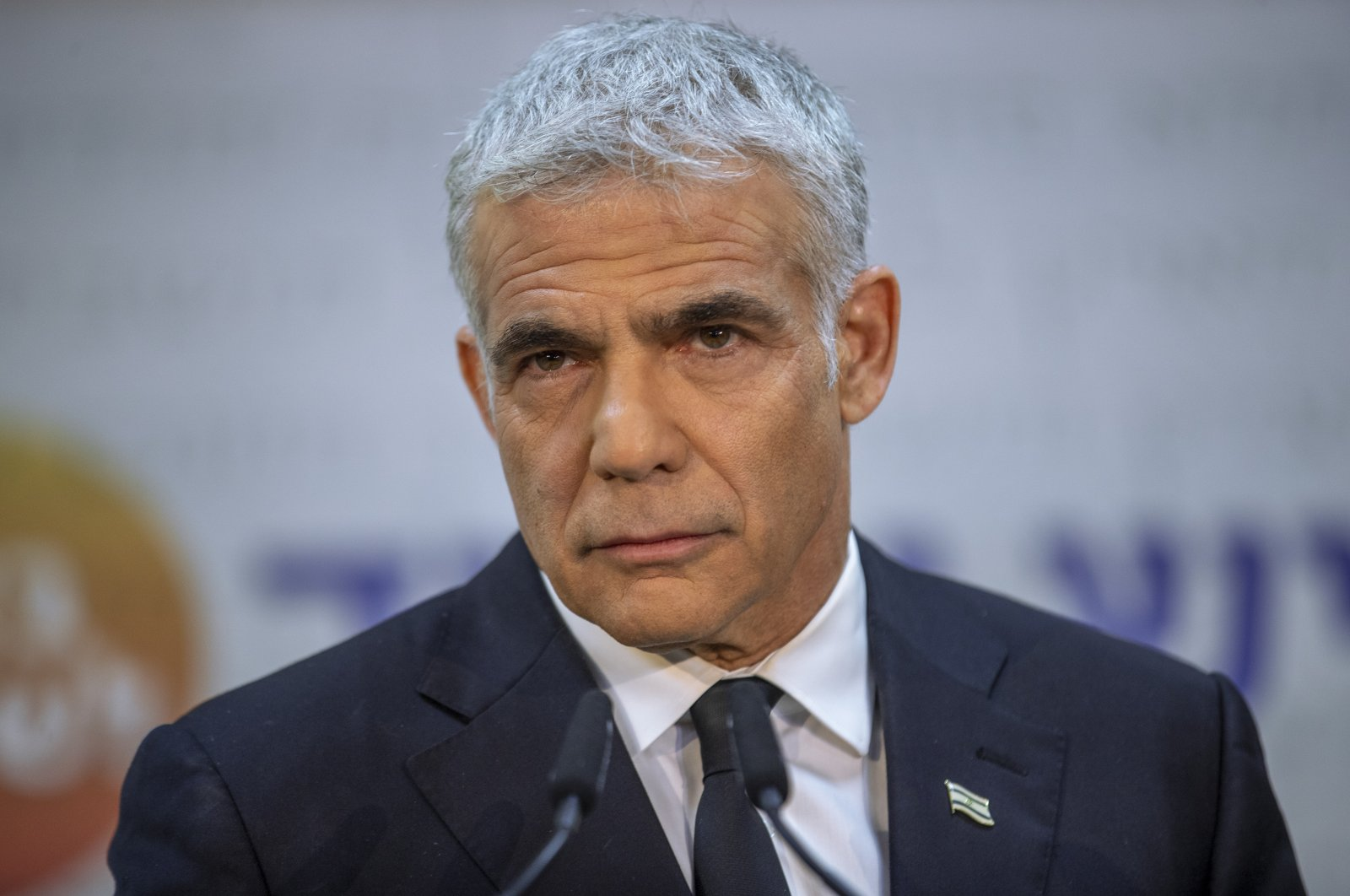 Israeli opposition leader Yair Lapid listens during a news conference in Tel Aviv, Israel, May 6, 2021. (AP Photo)