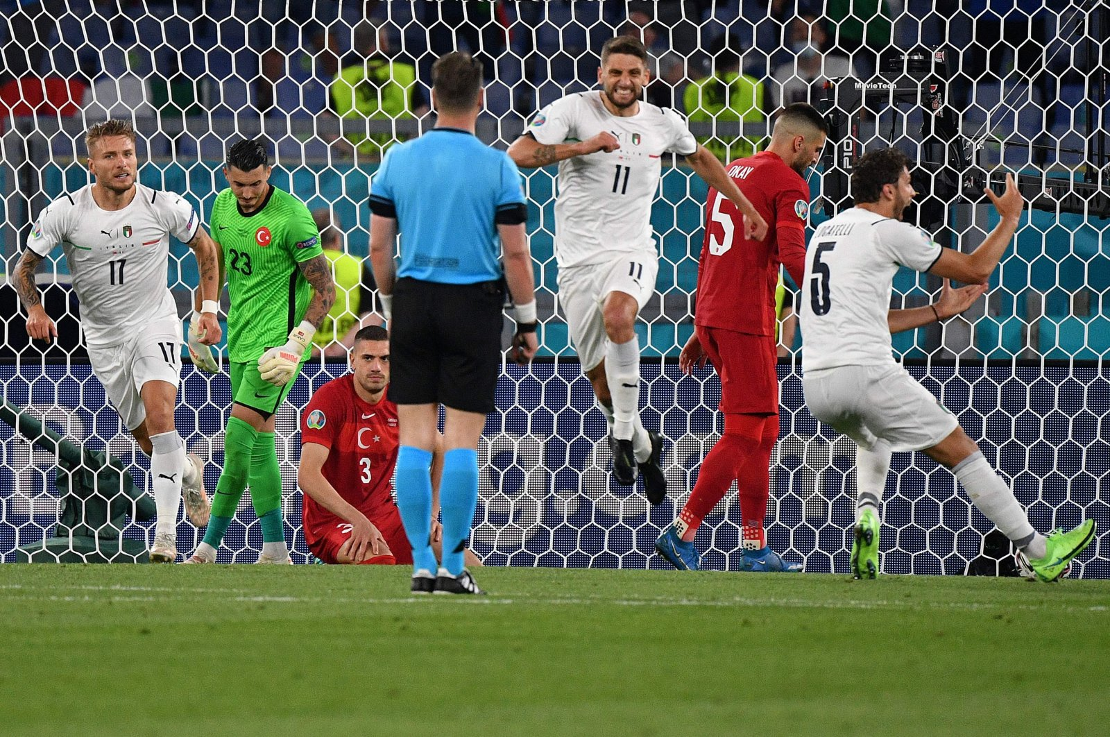 Italy's forward Domenico Berardi (C) celebrates their third goal scored by Italy's forward Lorenzo Insigne during the UEFA EURO 2020 Group A football match between Turkey and Italy at the Olympic Stadium in Rome on June 11, 2021. (AFP Photo)