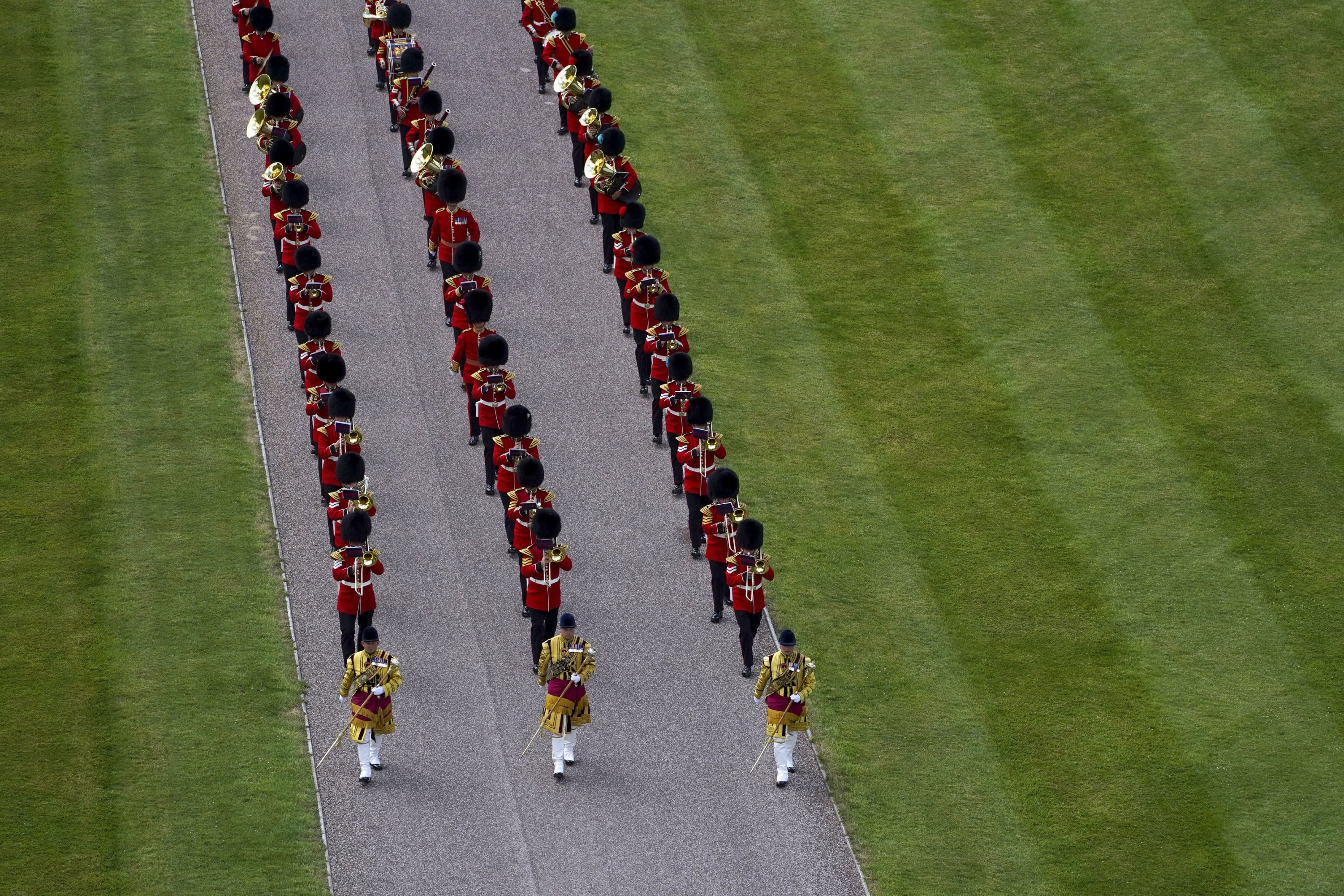 The massed band of the Household Division arrive at Windsor Castle, Windsor, England, during a military ceremony to mark the official birthday of Queen Elizabeth II, Saturday June 12, 2021. (Pool via AP)