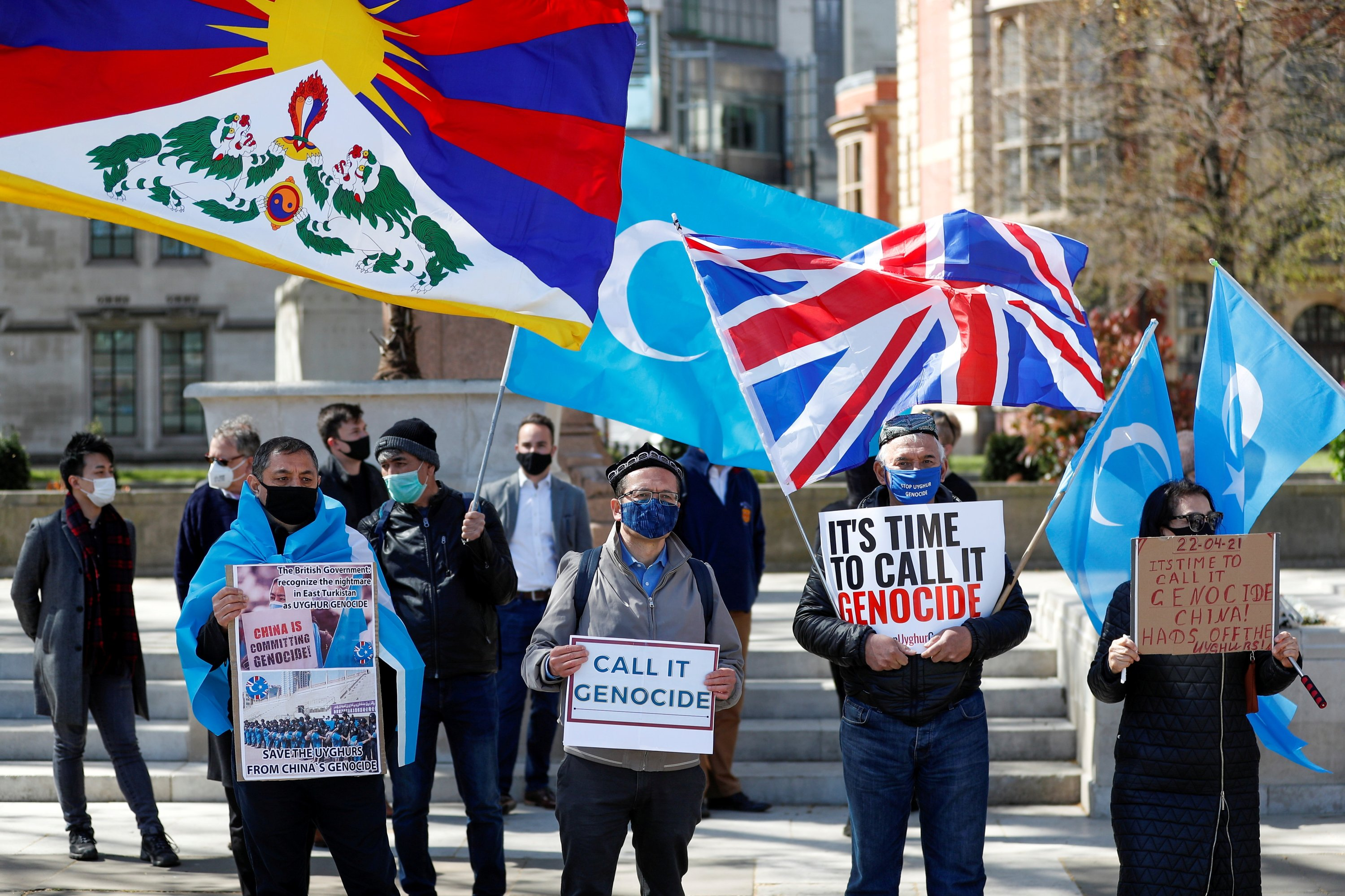 Demonstrators hold placards during a protest against the Uyghur genocide, in London, Britain, April 22, 2021. (Reuters Photo)