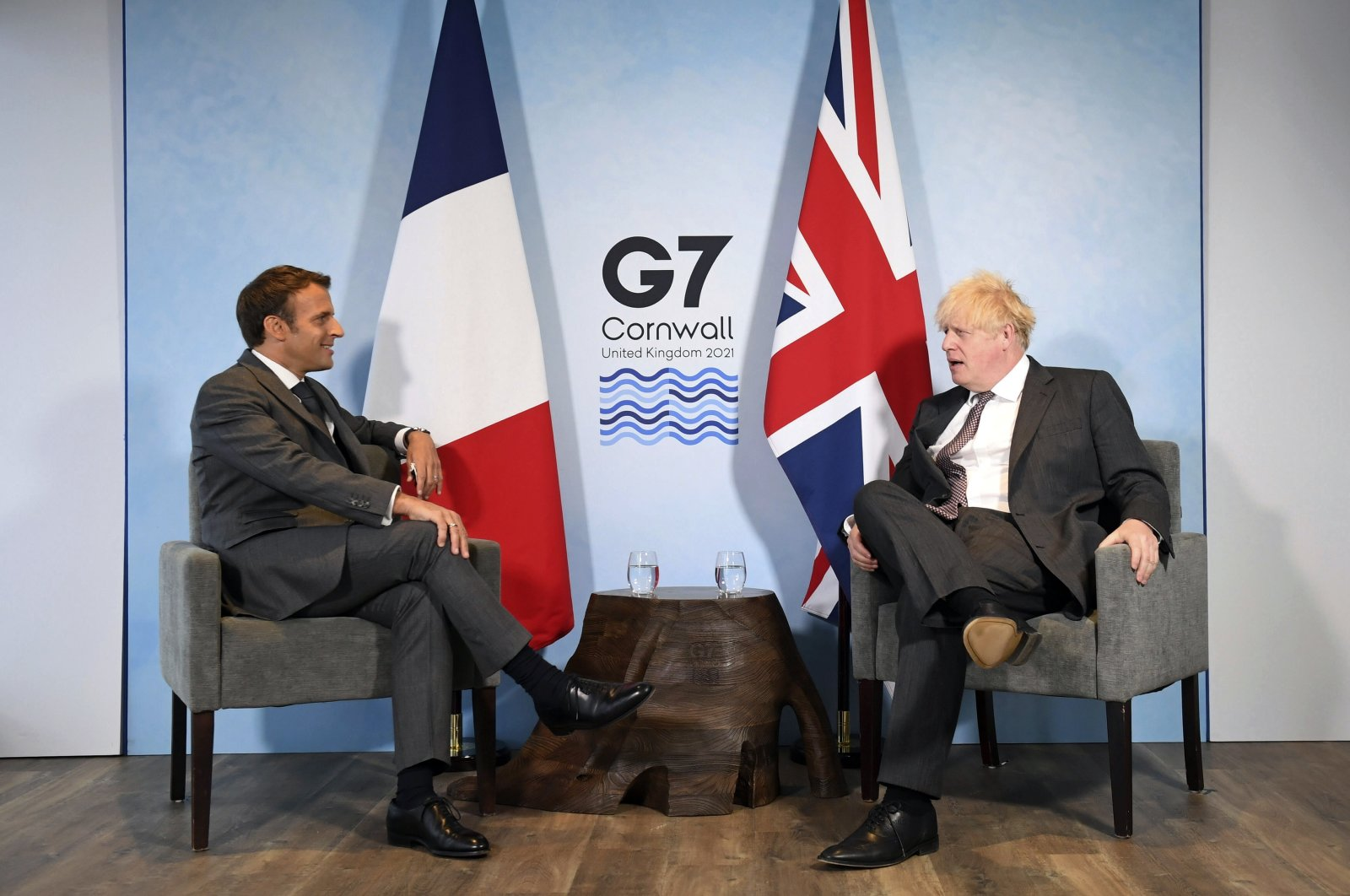 Britain's Prime Minister Boris Johnson (R) and French President Emmanuel Macron ahead of a bilateral meeting during the G-7 summit in Cornwall, England, June 12, 2021. (Pool via AP)