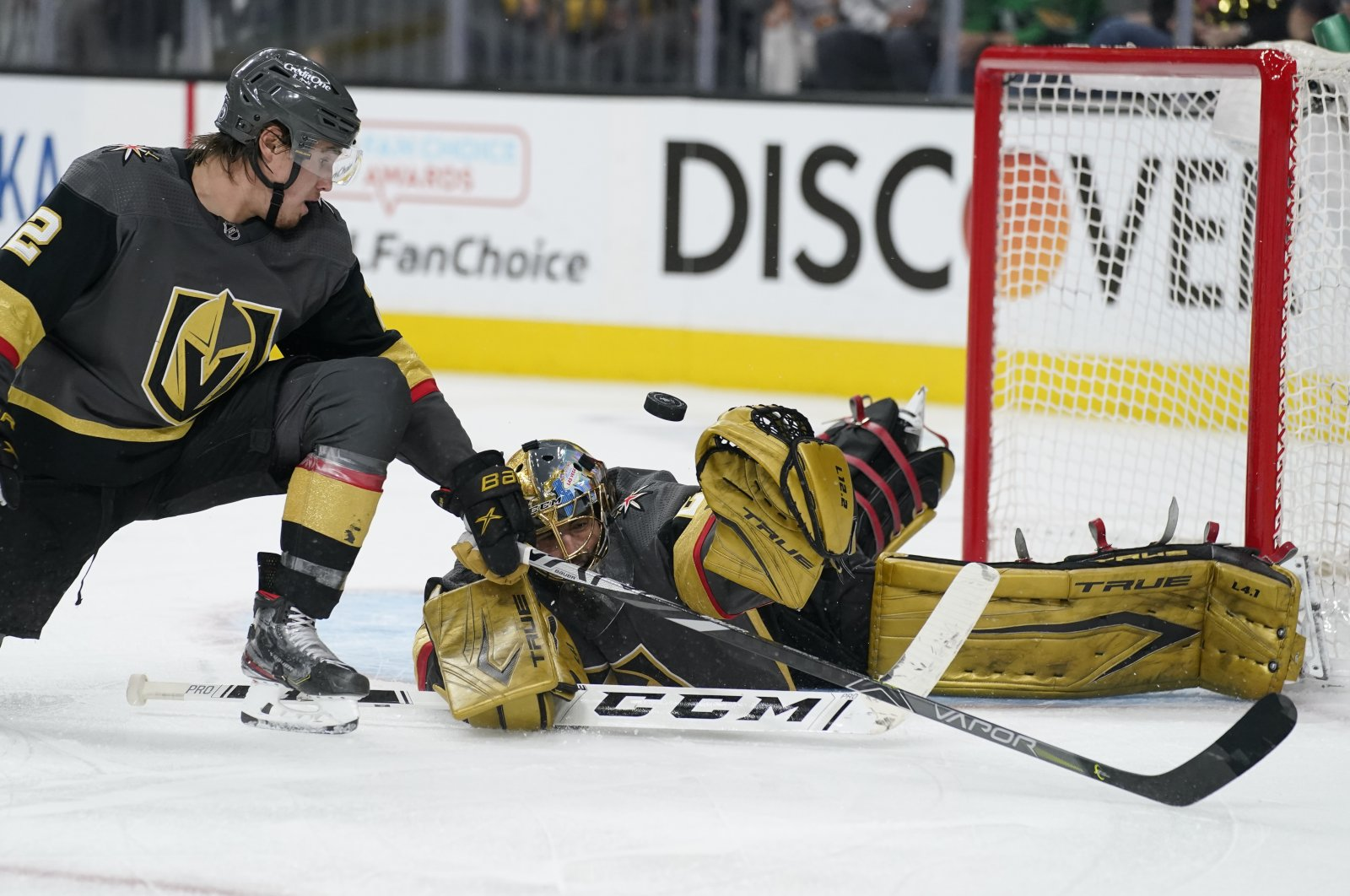 Vegas Golden Knights goaltender Marc-Andre Fleury (29) makes a save against the Colorado Avalanche as Vegas Golden Knights defenseman Zach Whitecloud (2) watches during the third period in Game 6 of an NHL hockey Stanley Cup second-round playoff series, Las Vegas, U.S., June 10, 2021. (AP Photo/John Locher)