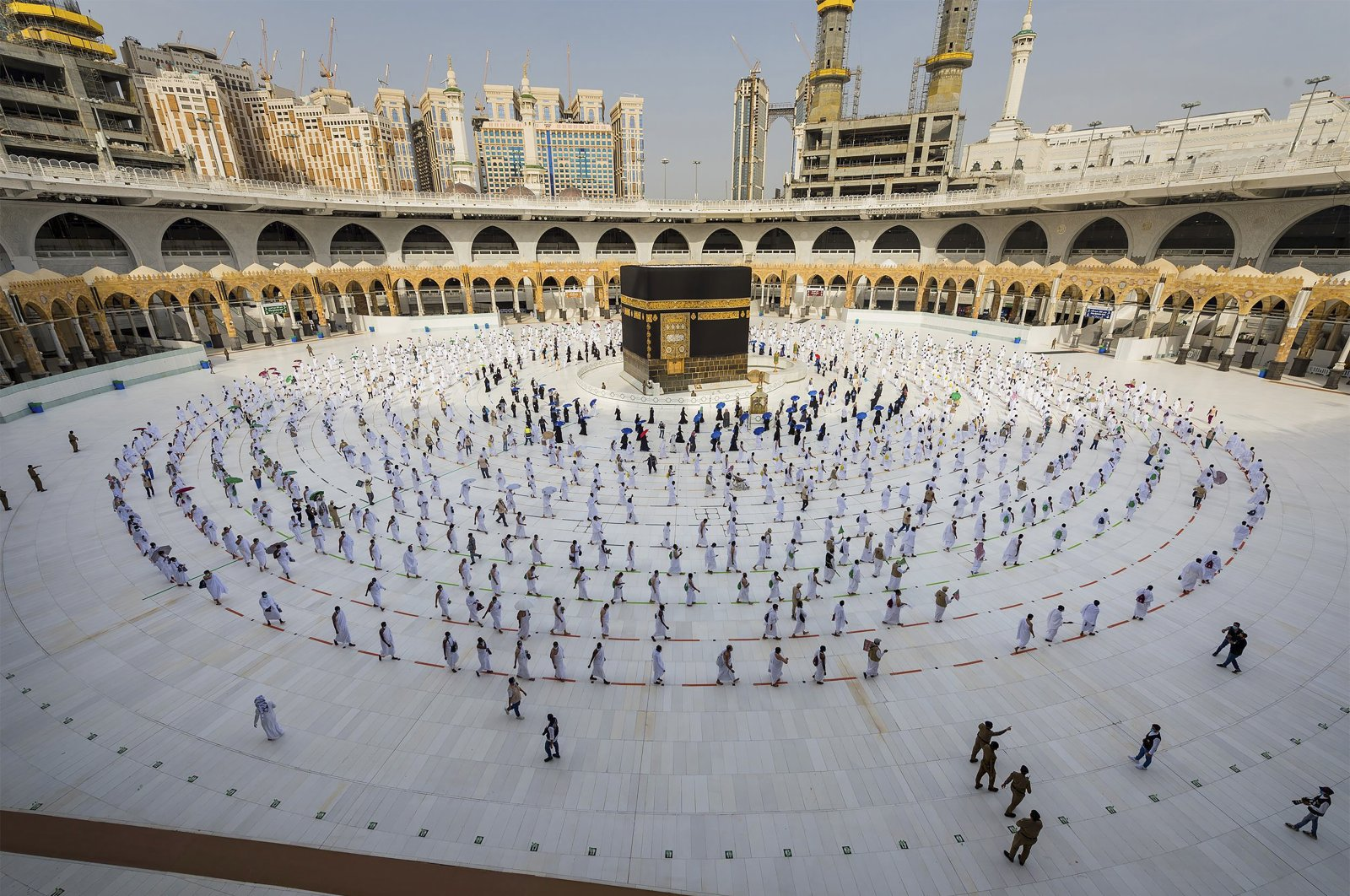 Pilgrims walk around the Kabba at the Grand Mosque in the Muslim holy city of Mecca, Saudi Arabia, July 31, 2020. (AP Photo)
