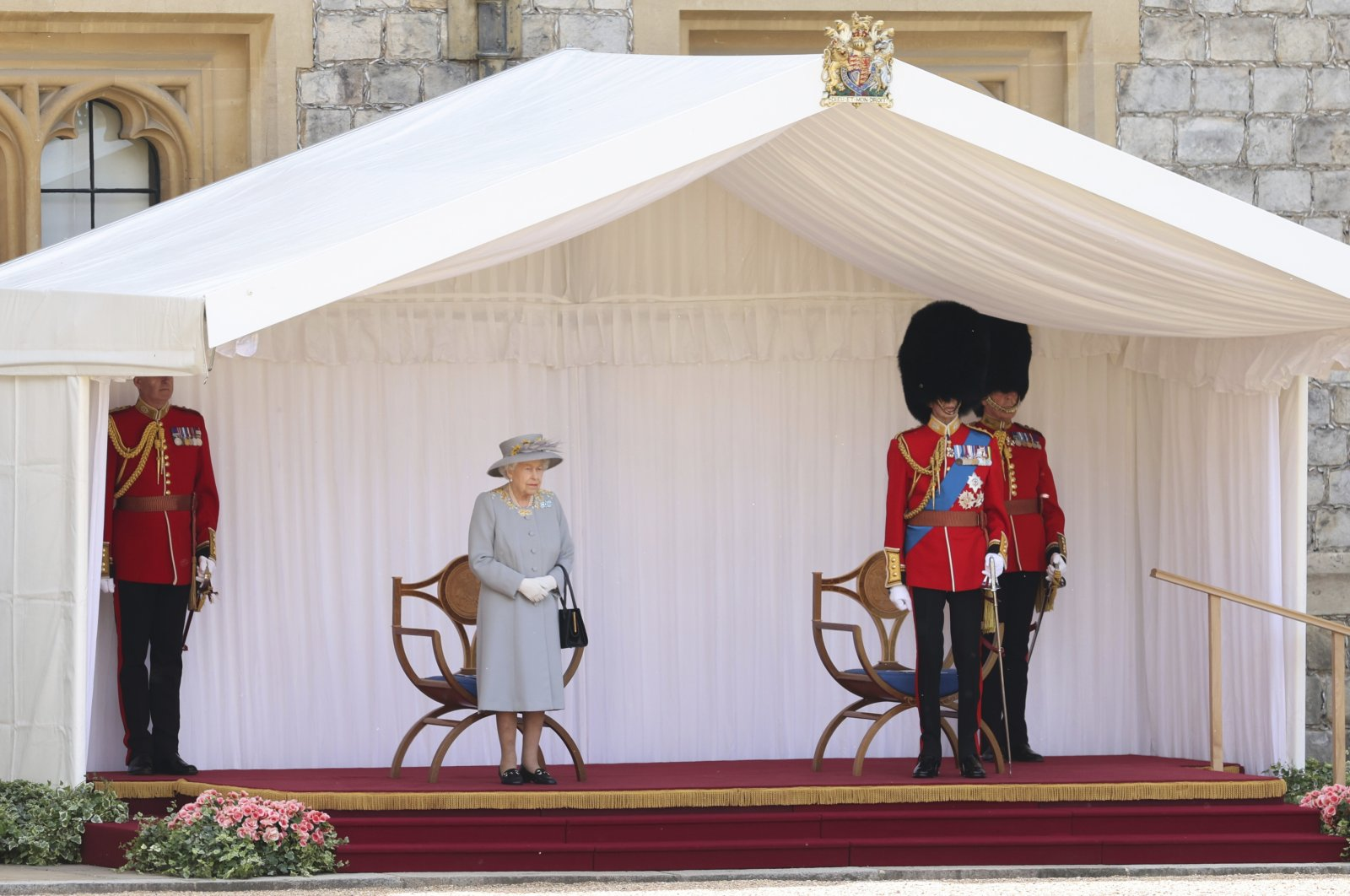 Britain's Queen Elizabeth II and the Duke of Kent watch a military ceremony to mark her official birthday at Windsor Castle, Windsor, England, June 12, 2021. (Pool via AP)